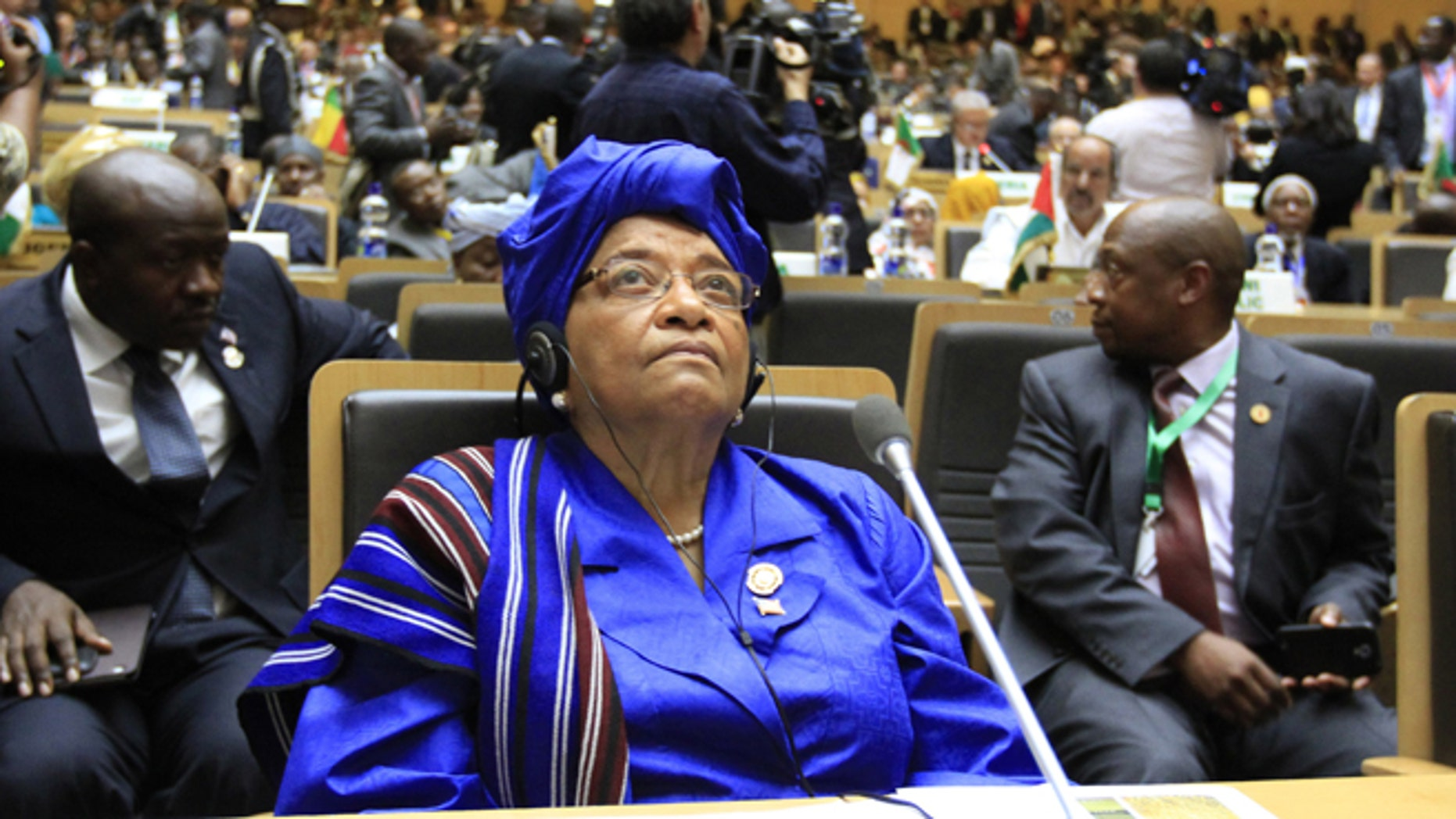 Liberian President Ellen Johnson-Sirleaf attends the opening ceremony of the 22nd Ordinary Session of the African Union summit in Ethiopia's capital Addis Ababa, January 30, 2014. The new president of Madagascar called on Thursday for an international donor conference in the next three months to help his island state recover from a political and economic crisis triggered by a coup five years ago. President Hery Rajaonarimampianina, who was sworn into office this month after elections passed off calmly in December, made his appeal at an African Union summit in Addis Ababa. REUTERS/Tiksa Negeri (ETHIOPIA - Tags: POLITICS) - RTX180W8