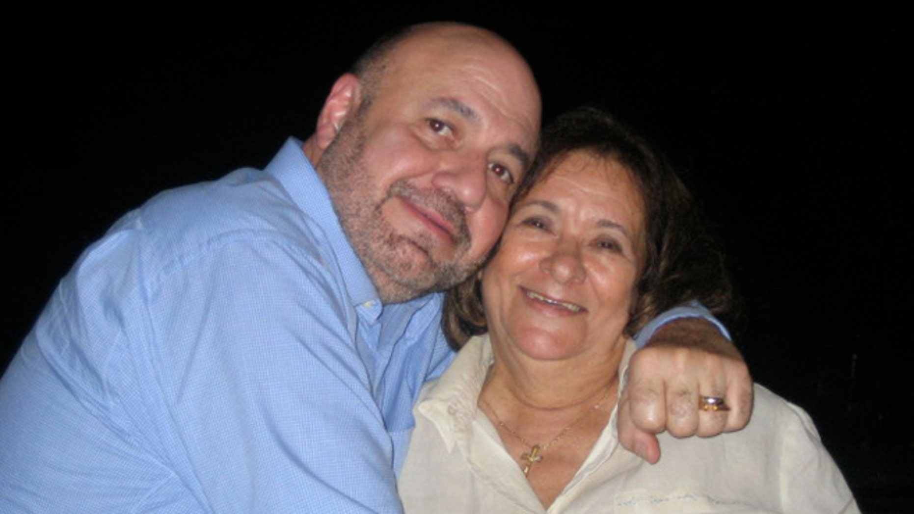 Dr. Manny poses with his mother, Elisa Alvarez.