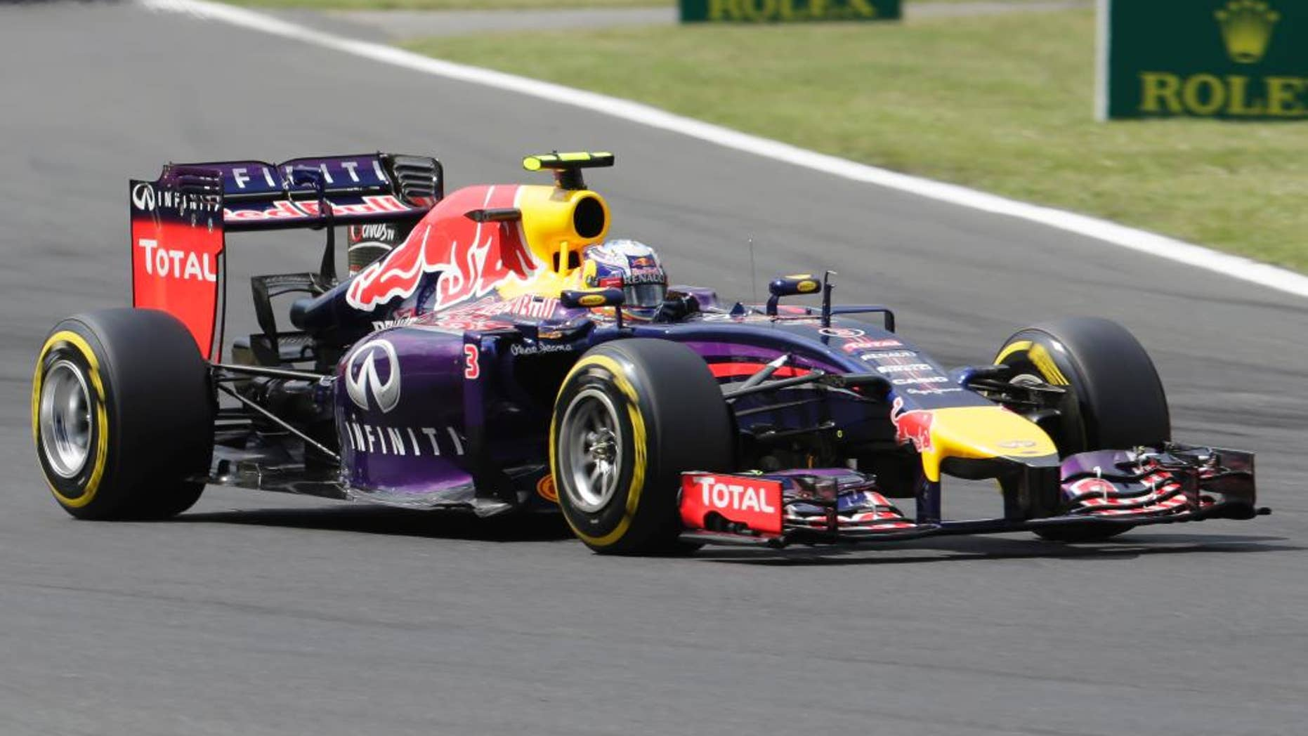 Red Bull driver Daniel Ricciardo of Australia steers his car during the qualifying of the Hungarian Formula One Grand Prix in Budapest, Hungary, Saturday, July 26, 2014. The Hungarian Grand Prix will be held on Sunday, July 27, 2014. (AP Photo/Petr David Josek)