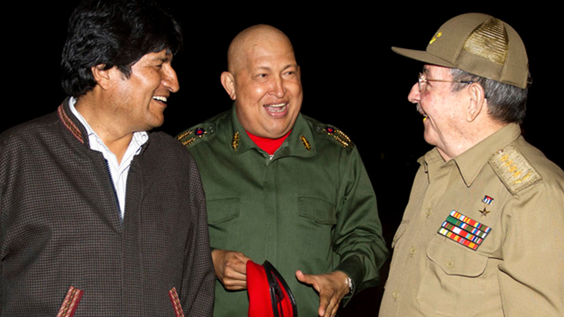 Sept. 18: In this picture released by the Agencia Boliviana de Informacion, Latin America  leaders, from left, Bolivia's President Evo Morales, Hugo Chavez and Cuba's President Raul Castro speak at the Jose Marti airport in Havana, Cuba.