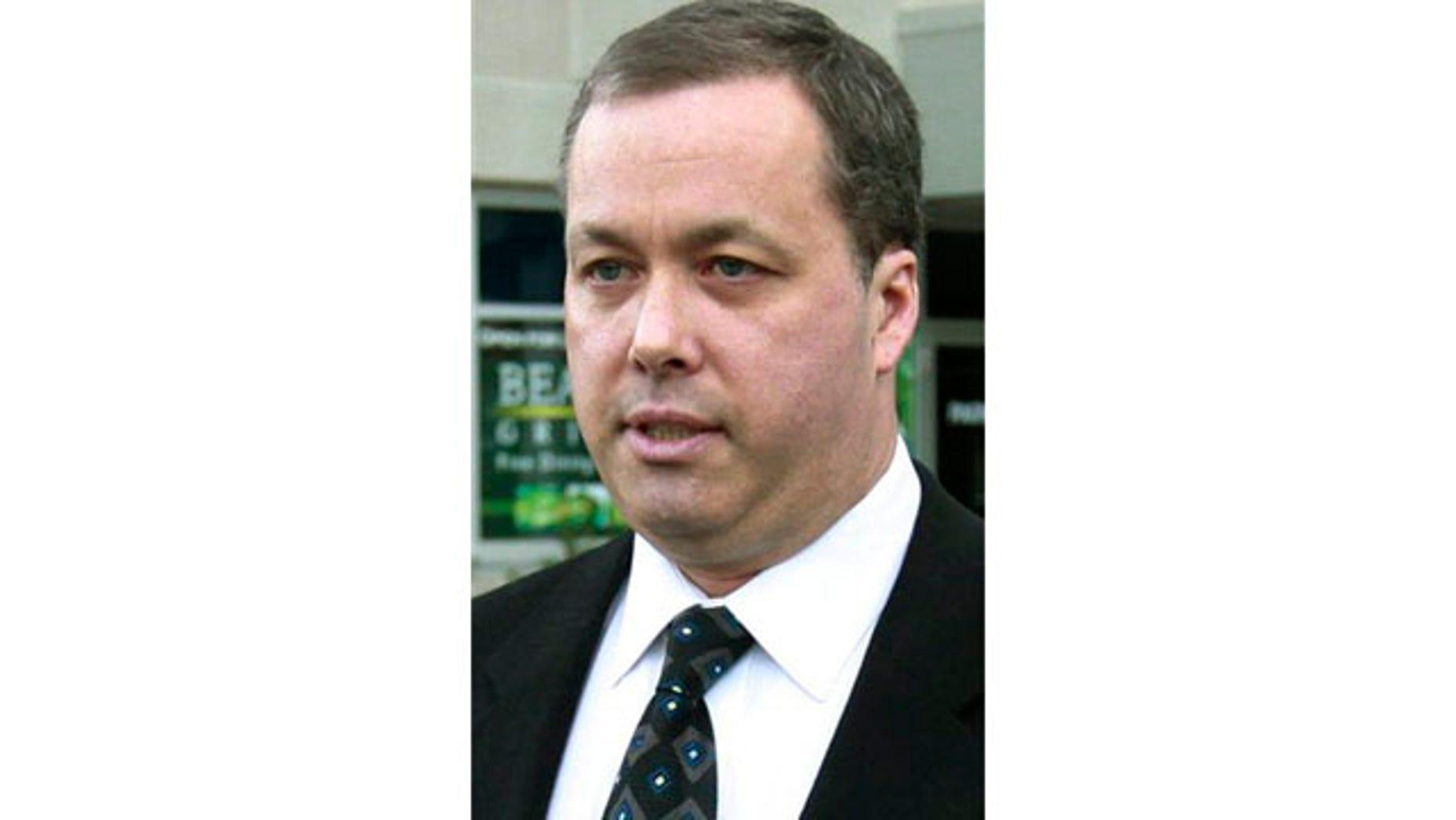 Nov. 18, 2010: Mark Kerrigan departs Middlesex Superior Court in Woburn, Mass.