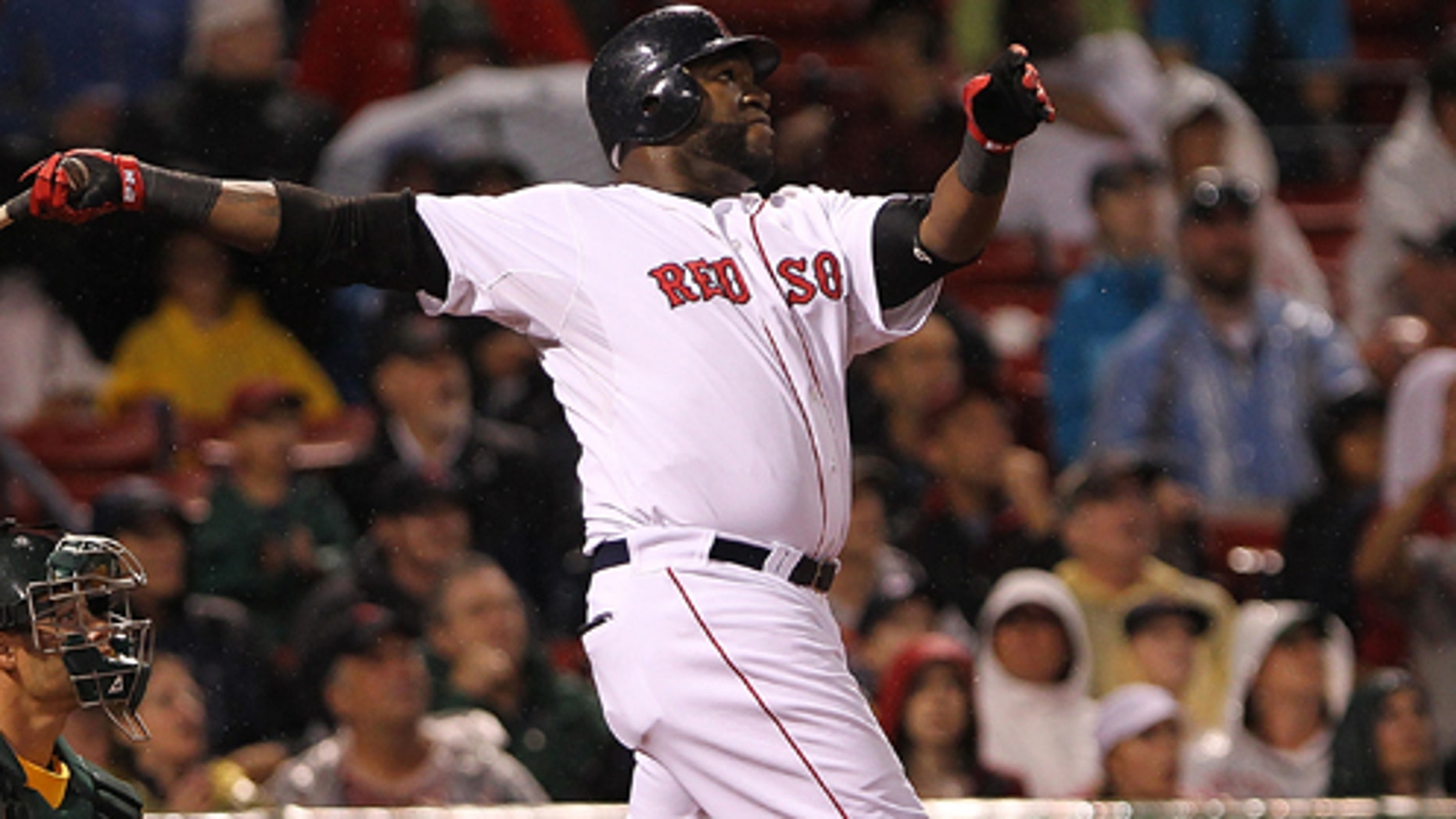 David Ortiz #34 of the Boston Red Sox hits a home run against the Oakland Athletics at Fenway Park on Aug. 27, 2011 in Boston, Massachusetts. (Photo by Jim Rogash/Getty Images)