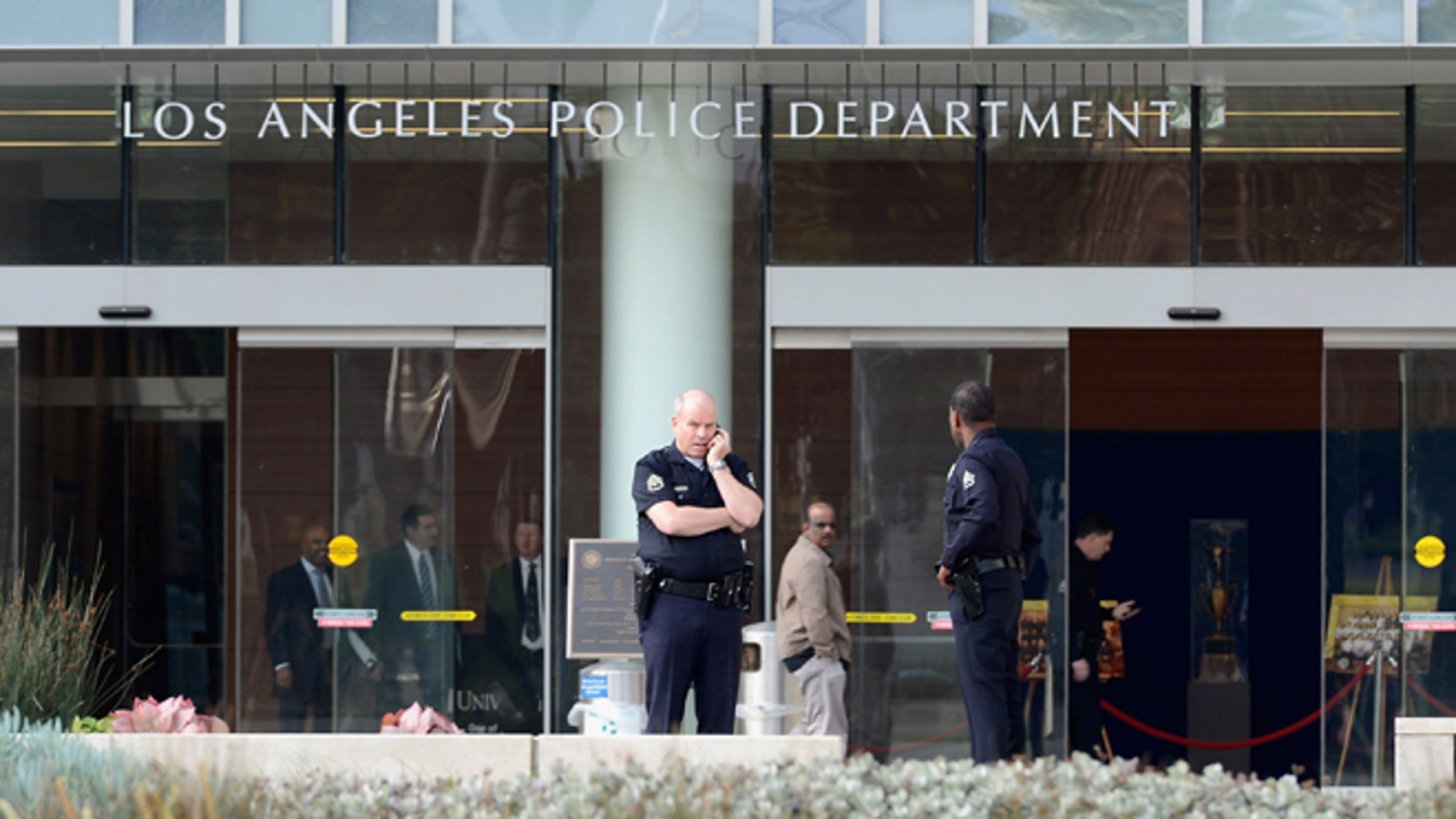 LAPD officers are deployed around the police headquarters on February 7, 2013 in Los Angeles.