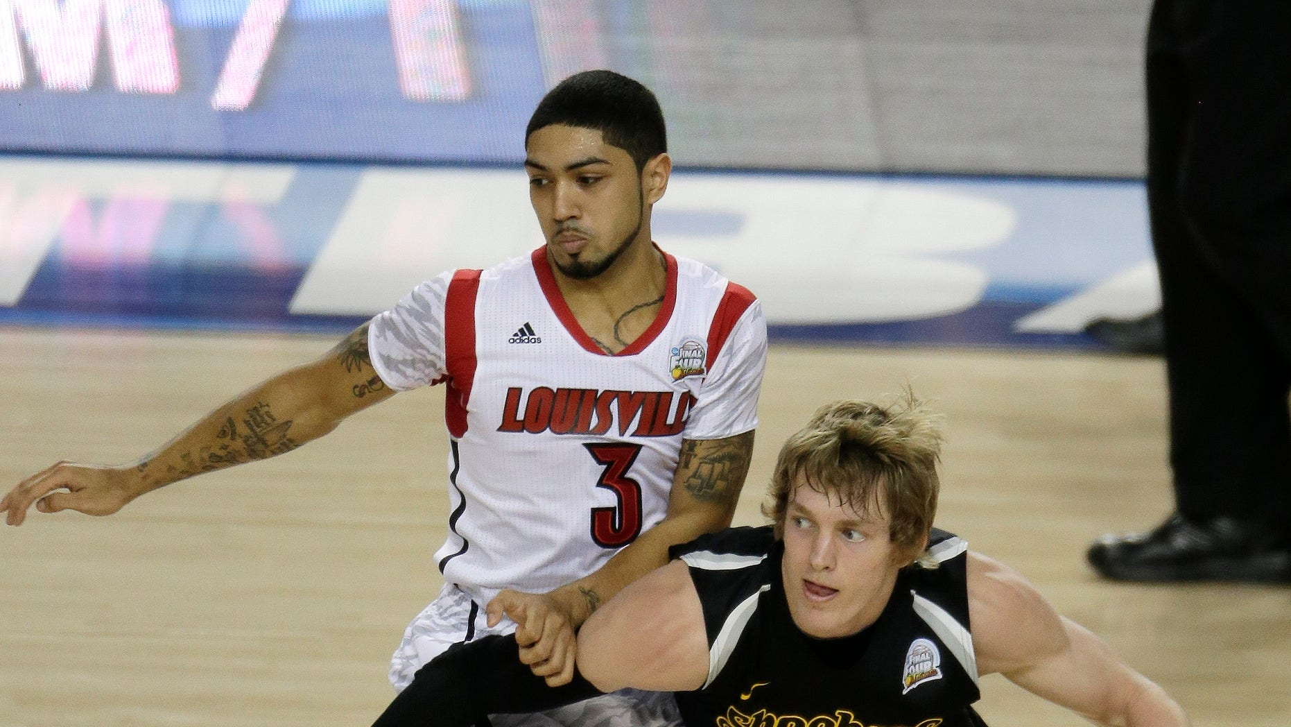 Wichita State's Ron Baker (31) moves around Louisville's Peyton Siva (3) during the first half of the NCAA Final Four tournament college basketball semifinal game Saturday, April 6, 2013, in Atlanta. (AP Photo/Chris O'Meara)