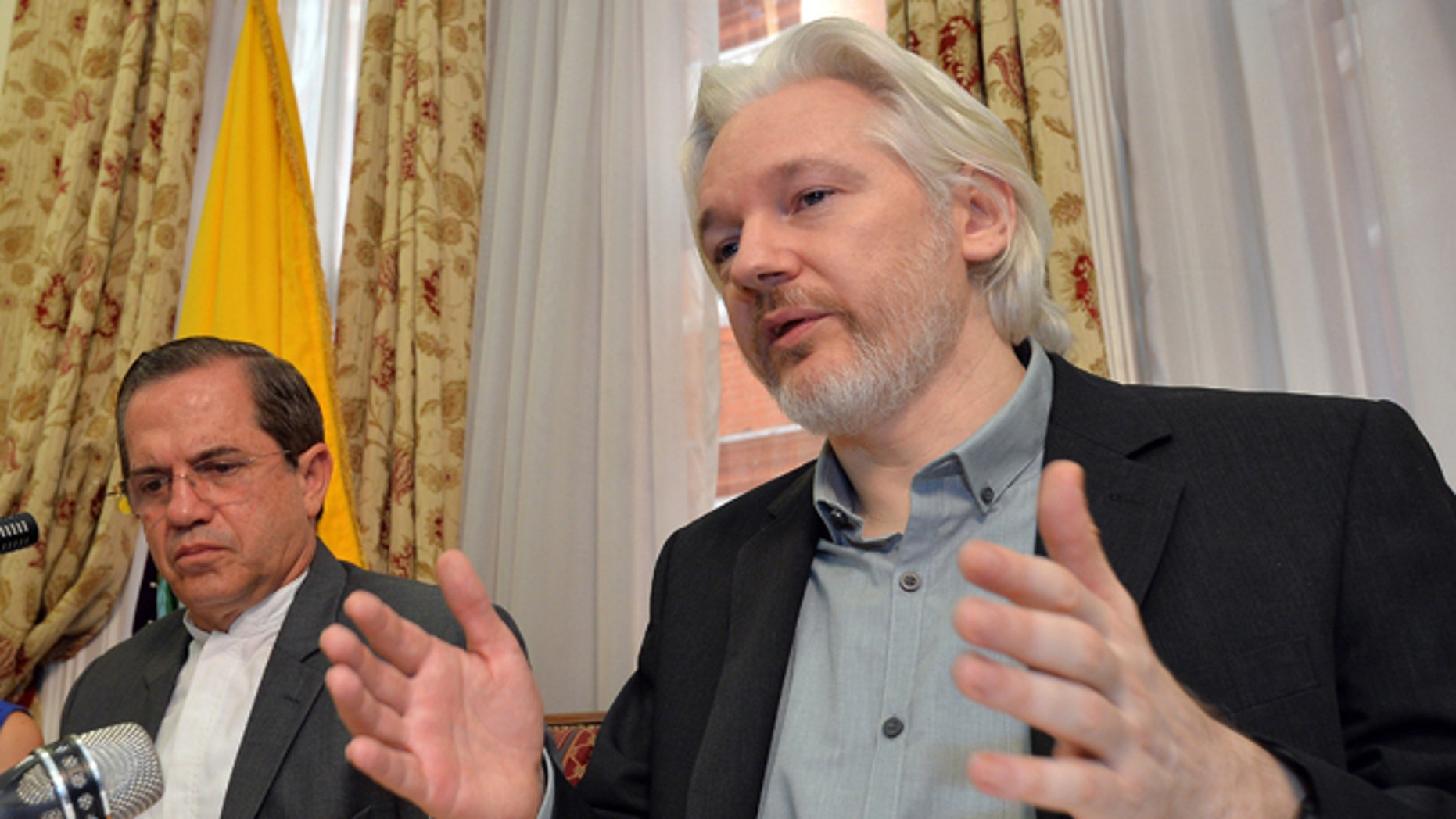 """LONDON, ENGLAND - AUGUST 18:  WikiLeaks founder Julian Assange (R) sits next to Ecuadorian Foreign Minister Ricardo Patino during a press conference, where he confirmed he """"will be leaving the embassy soon"""", in the Ecuadorian Embassy on August 18, 2014 in London, England. Mr Assange has been living in the embassy since June 2012 in an attempt to avoid extradition to Sweden where he faces allegations of sexual assault.  (Photo by John Stillwell - WPA Pool/Getty Images)"""