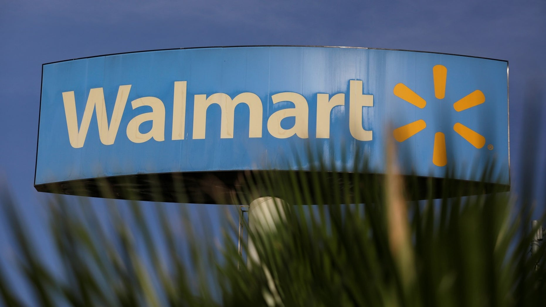 Walmart apologized for a sign over a gun display in an Indiana store.