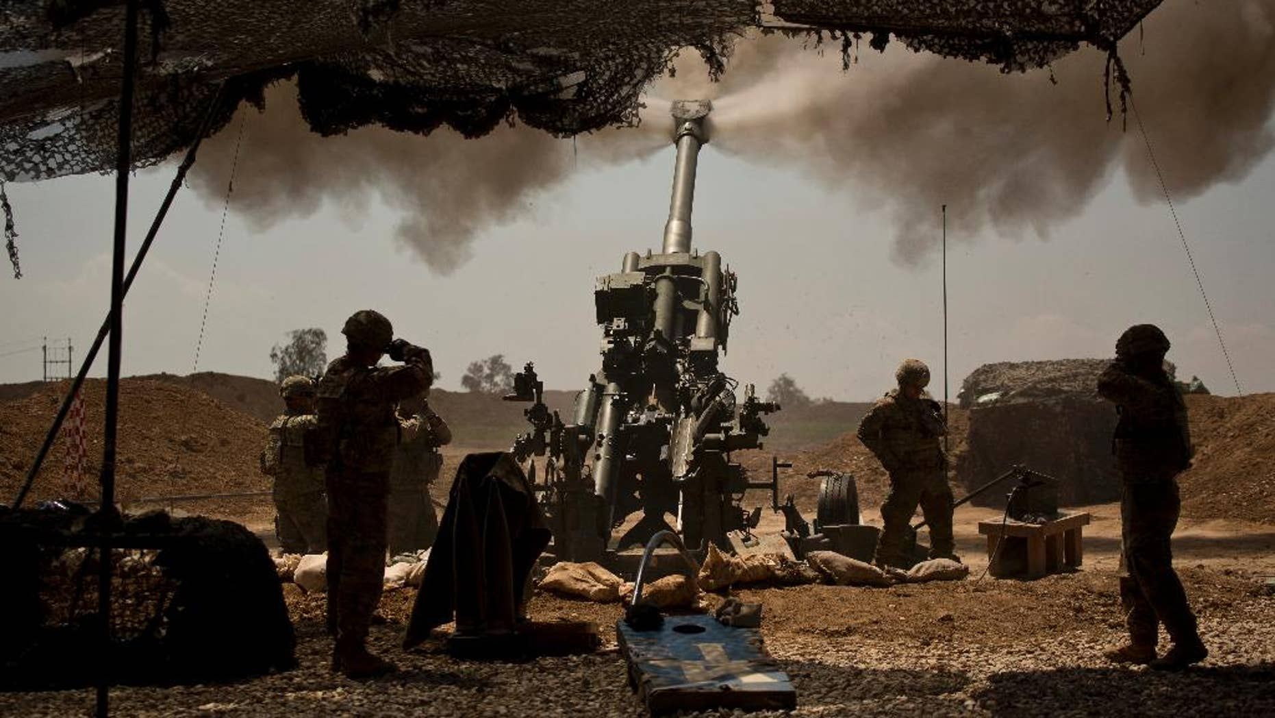 U.S. soldiers from the 82nd Airborne Division fire artillery in support of Iraqi forces fighting Islamic State militants from their base east of Mosul on Monday, April 17, 2017. The soldiers are from C Battery, 2nd Battalion, 319th Airborne Field Artillery Regiment. (AP Photo/Maya Alleruzzo)