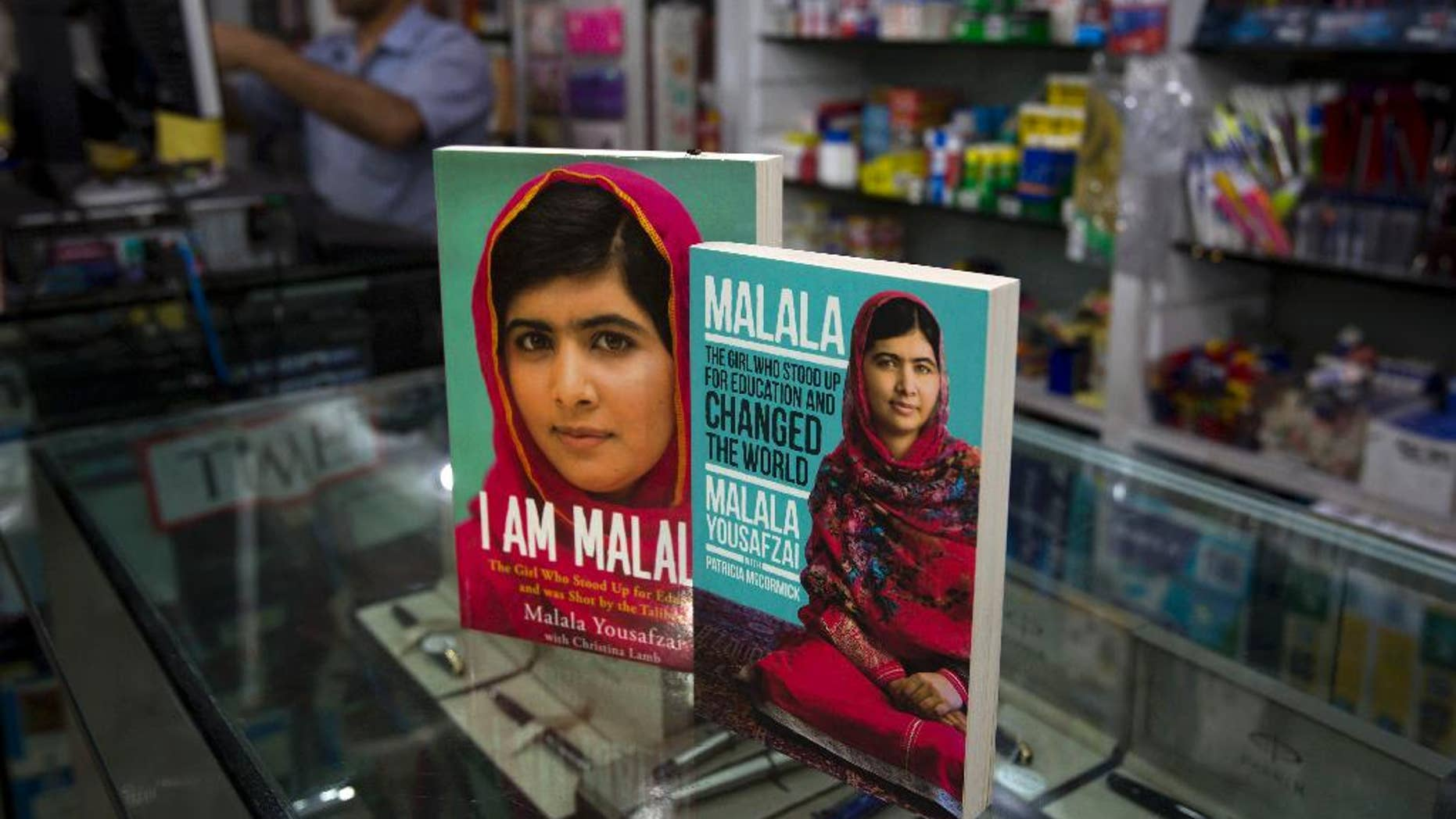 Books about Pakistan's Nobel Prize winner Malala Yousafzai, who survived a Taliban attack, are displayed at a book store in Islamabad, Pakistan, Thursday, April 30, 2015. A Pakistani court on Thursday sentenced 10 militants to life in prison for their involvement in the 2012 attack on teenage activist Malala Yousafzai, a public prosecutor said. (AP Photo/B.K. Bangash)