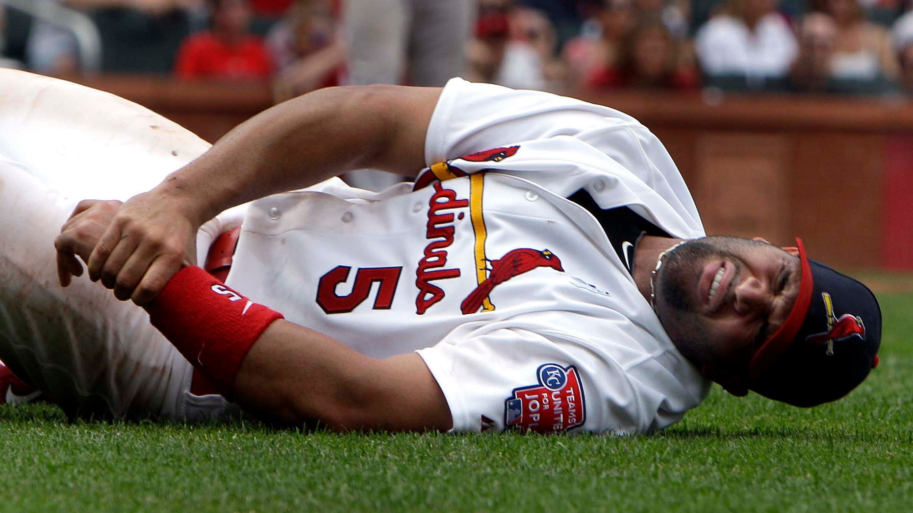 June 19: St. Louis Cardinals first baseman Albert Pujols injured his left wrist in the sixth inning in a game against the Kansas City Royals. (AP Photo/Jeff Roberson)