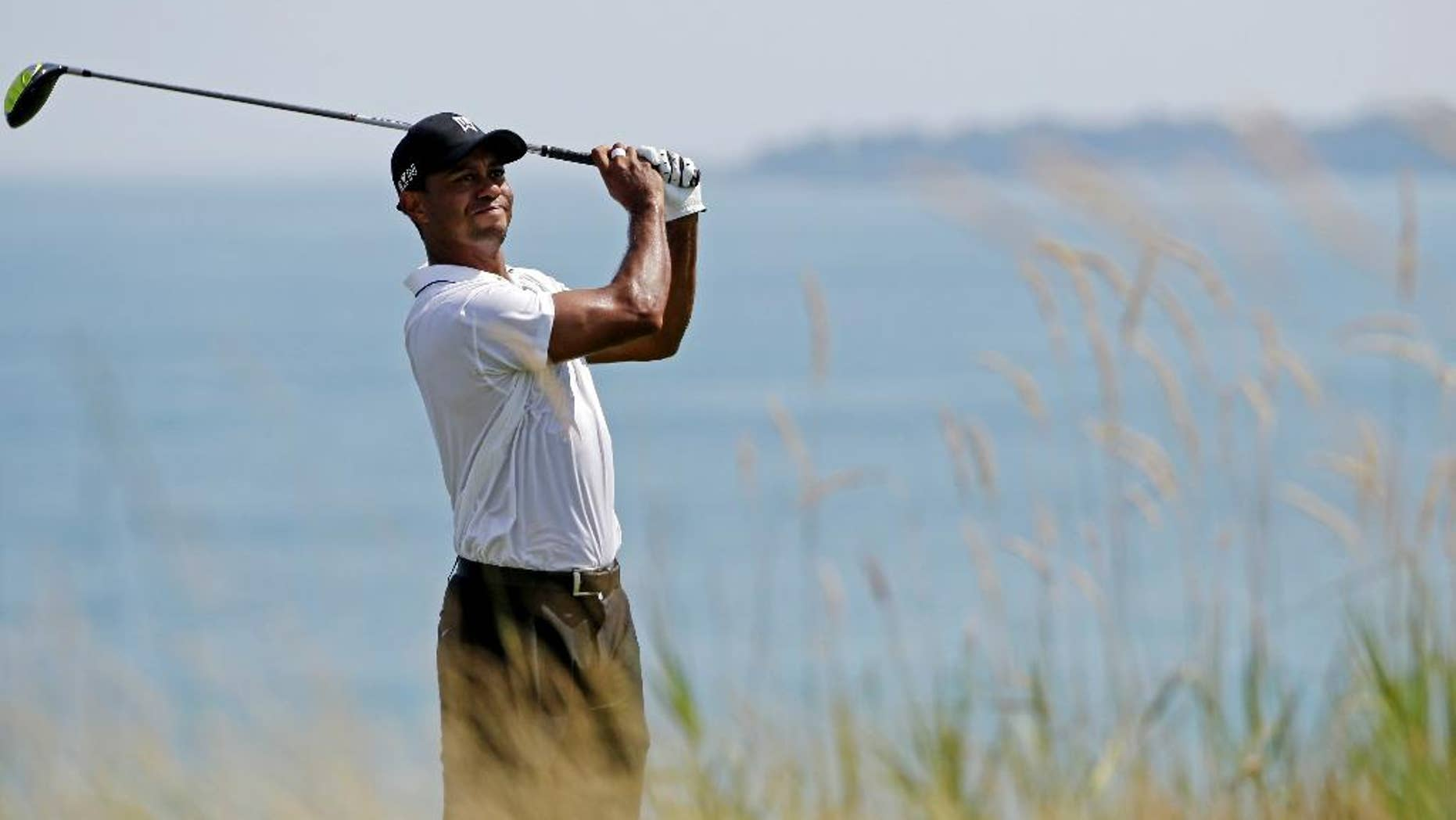 Tiger Woods hits on the fifth hole during the second round of the PGA Championship golf tournament Friday, Aug. 14, 2015, at Whistling Straits in Haven, Wis. (AP Photo/Brynn Anderson)