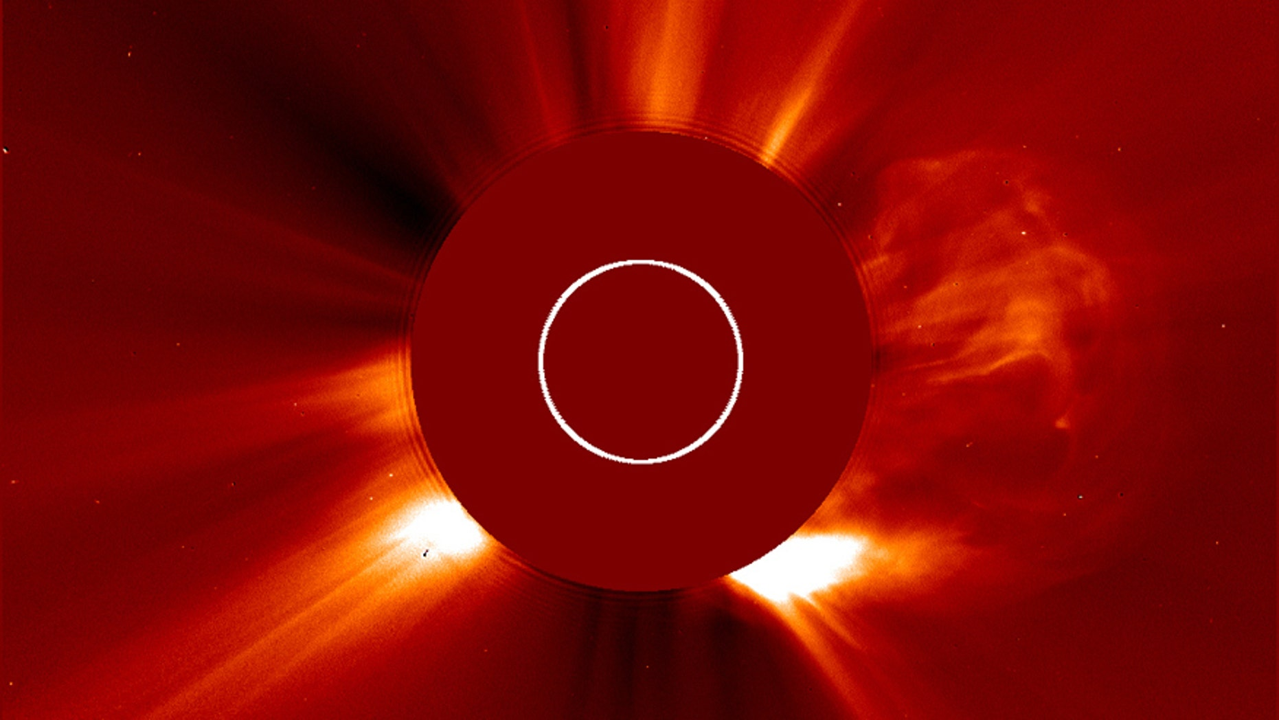 On the right side, a cloud of solar material ejects from the sun in one of the fastest coronal mass ejections (CMEs) ever measured.