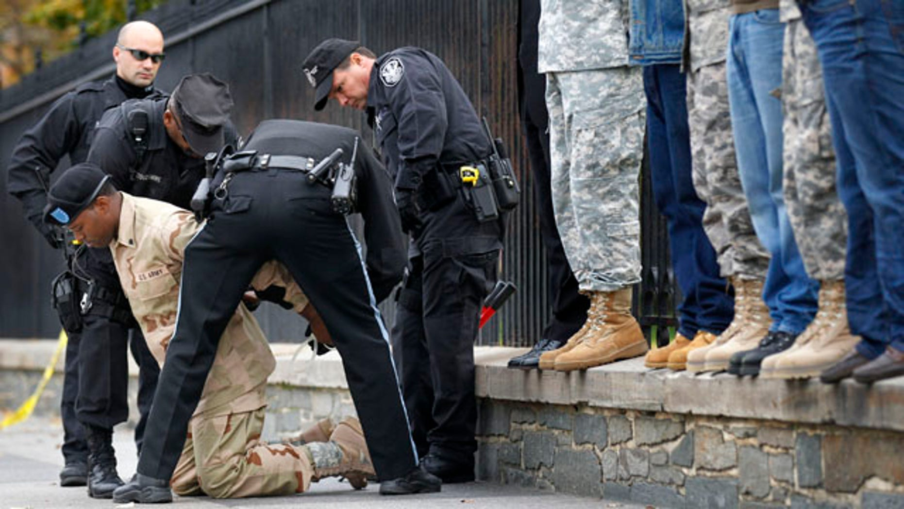 """Nov. 15: U.S. Army Veteran Rob Smith is arrested for handcuffing himself to the fence outside the White House in Washington, D.C., during a protest for gay rights. Smith was part of a group demanding that President Obama make good on his promise to secure the repeal of """"don't ask, don't tell."""""""