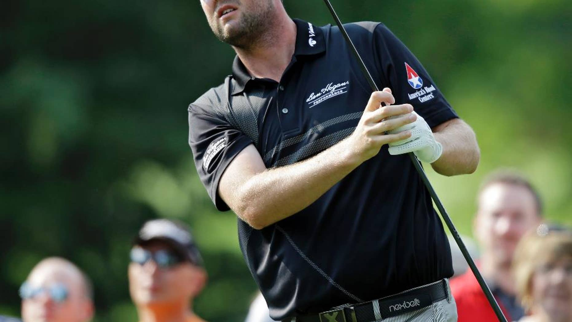 FILE - In this Aug. 2, 2014, file photo, Marc Leishman watches his drive on the third hole during the third round of the Bridgestone Invitational golf tournament at Firestone Country Club in Akron, Ohio. Lieshman, who has missed recent Tour events for family reasons, returns this week at the Zurich Classic in New Orleans. (AP Photo/Mark Duncan, File)