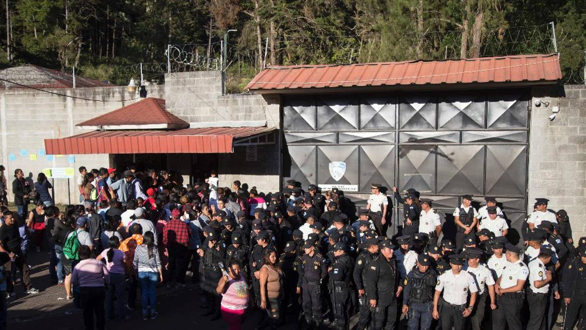 "FILE - In this March 8, 2017 file photo, National Police guard the entrance to the Virgen de la Asuncion Safe Home, in San Jose Pinula, Guatemala. In November, a state human rights prosecutor filed a complaint with the Inter American Human Rights Commission charging rampant abuses at the shelter. The accusations included charges as serious as ""forced recruitment for human trafficking for the purpose of prostitution."" (AP Photo/Luis Soto, File)"