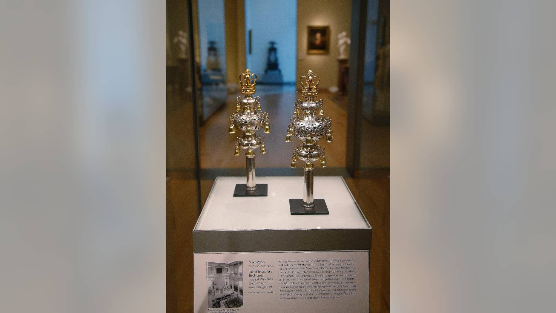 """FILE - In this June 1, 2015, file photo, ceremonial bells belonging to the 250-year-old Touro Synagogue in Newport, R.I., and worth more than $7 million are on display at the Museum of Fine Arts in Boston. A federal judge overseeing a trial over control of the nation's oldest synagogue and ceremonial bells said on Friday, Sept. 18, there is no """"smoking gun,"""" in the battle between the congregation that worships at the 250-year-old Touro Synagogue in Newport and the nation's first Jewish congregation, in New York. (AP Photo/Stephan Savoia, File)"""