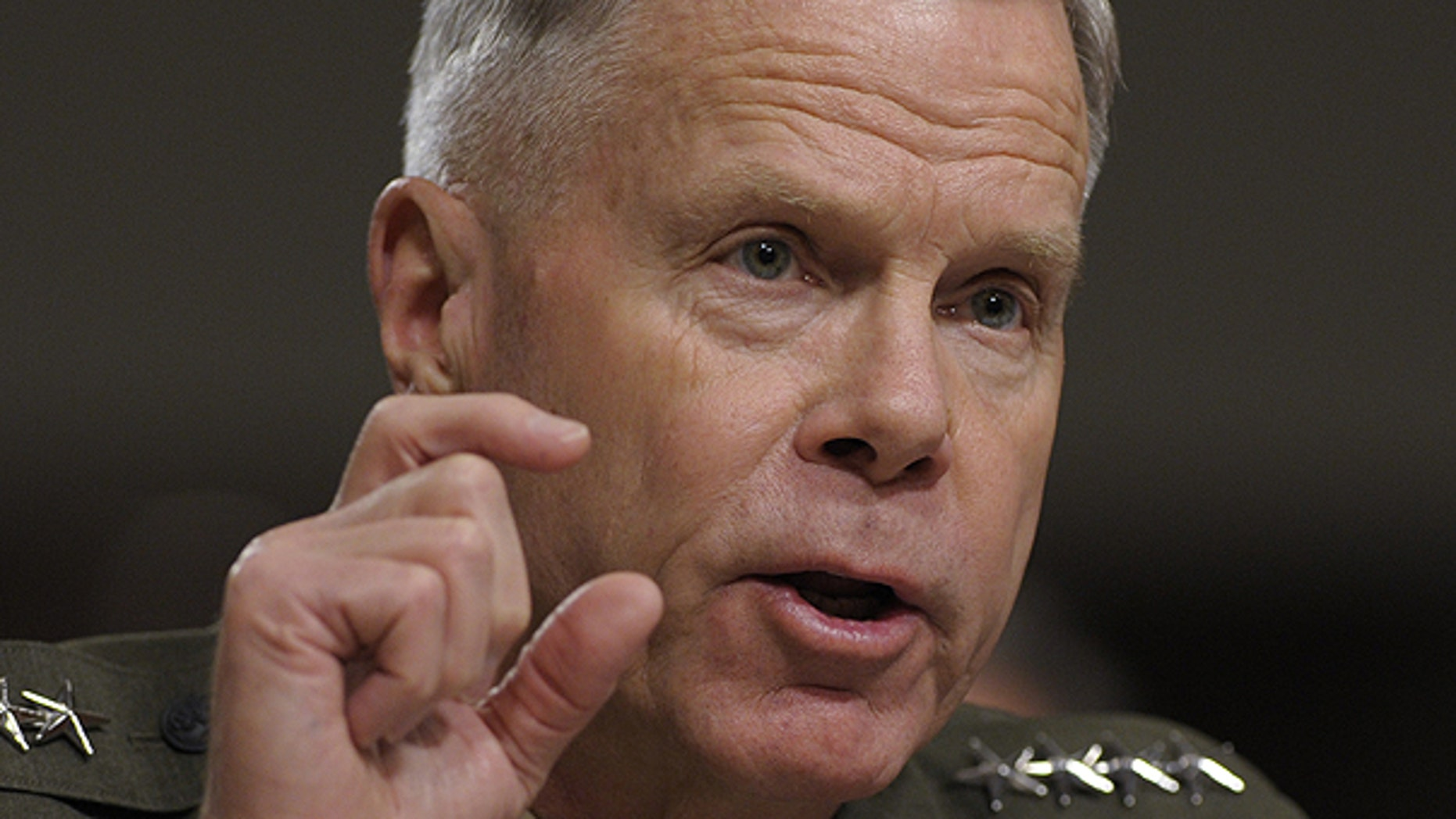 FILE: Gen. James Amos, assistant commandant of the U.S. Marine Corps, testifies on Capitol Hill in Washington on June 22, before the Senate Armed Services Committee hearing.