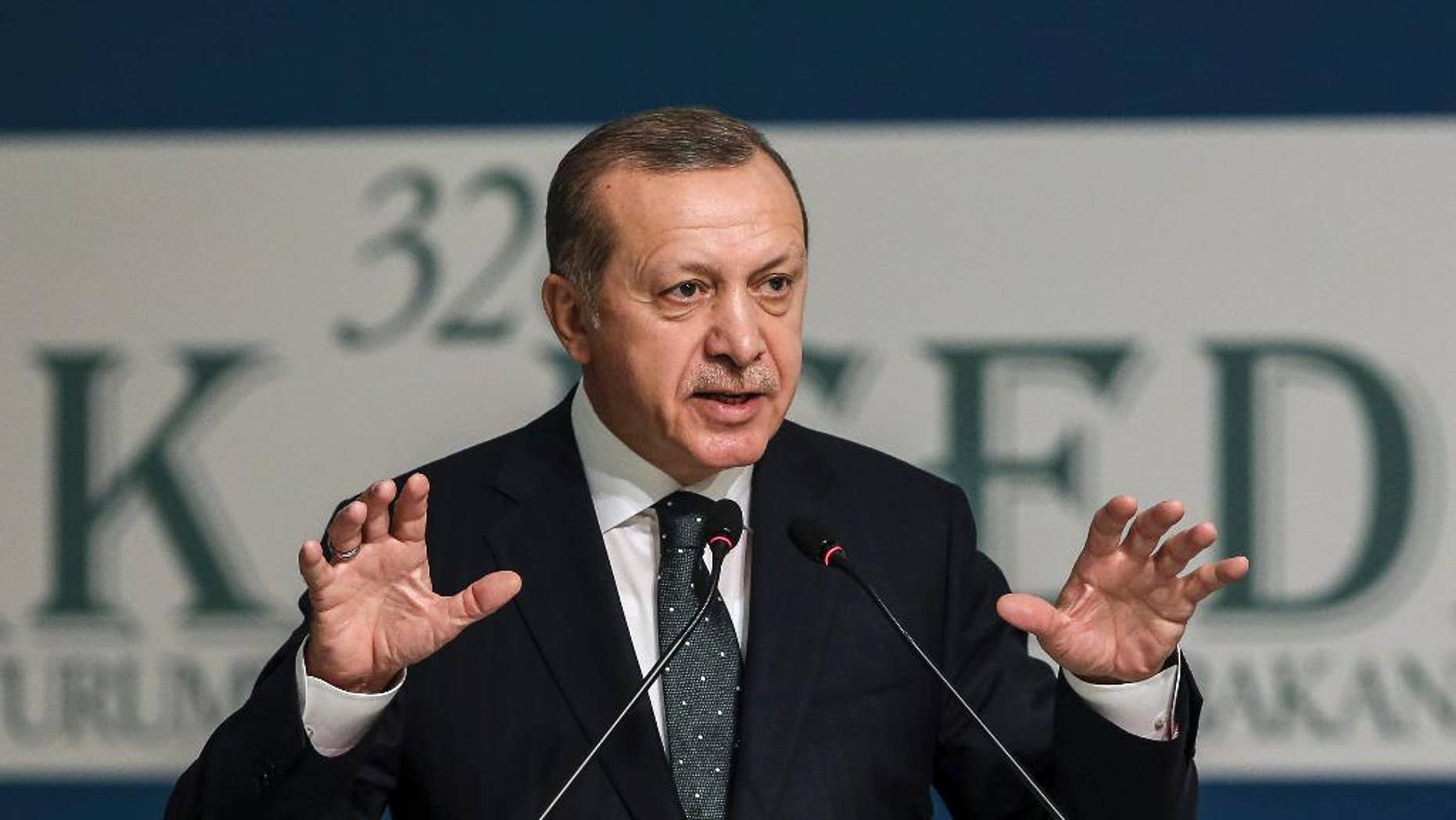 "Turkey's President Recep Tayyip Erdogan addresses an annual economy and trade meeting of the Organization for Islamic Cooperation in Istanbul, Wednesday, Nov. 23, 2016. Erdogan declared Wednesday that an upcoming vote in the European Parliament on whether to freeze membership talks with Turkey is of ""no value"" to his country.(Yasin Bulbul, Presidential Press Service/Pool Photo via AP)"