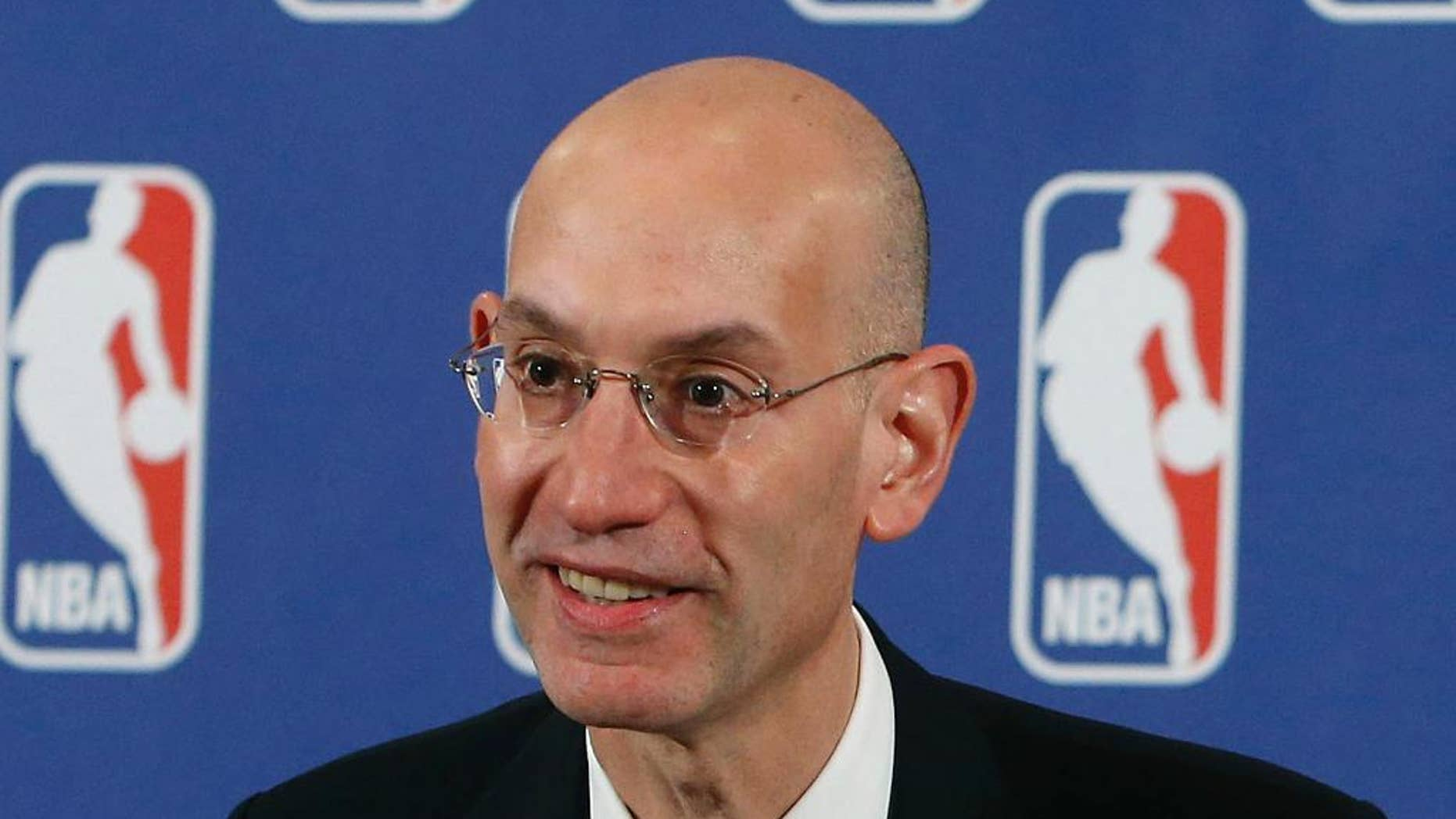 "FILE - In this May 21, 2013, file photo, Adam Silver speaks during a news conference before the NBA basketball draft lottery in New York. The NBA has suspended Charlotte Hornets forward Jeffery Taylor for 24 games without pay after he pleaded guilty last month to misdemeanor domestic violence assault and malicious destruction of hotel property. ""This suspension is necessary to protect the interests of the NBA and the public's confidence in it,"" NBA Commissioner Silver said in a release Wednesday, Nov. 19, 2014. (AP Photo/Jason DeCrow, File)"