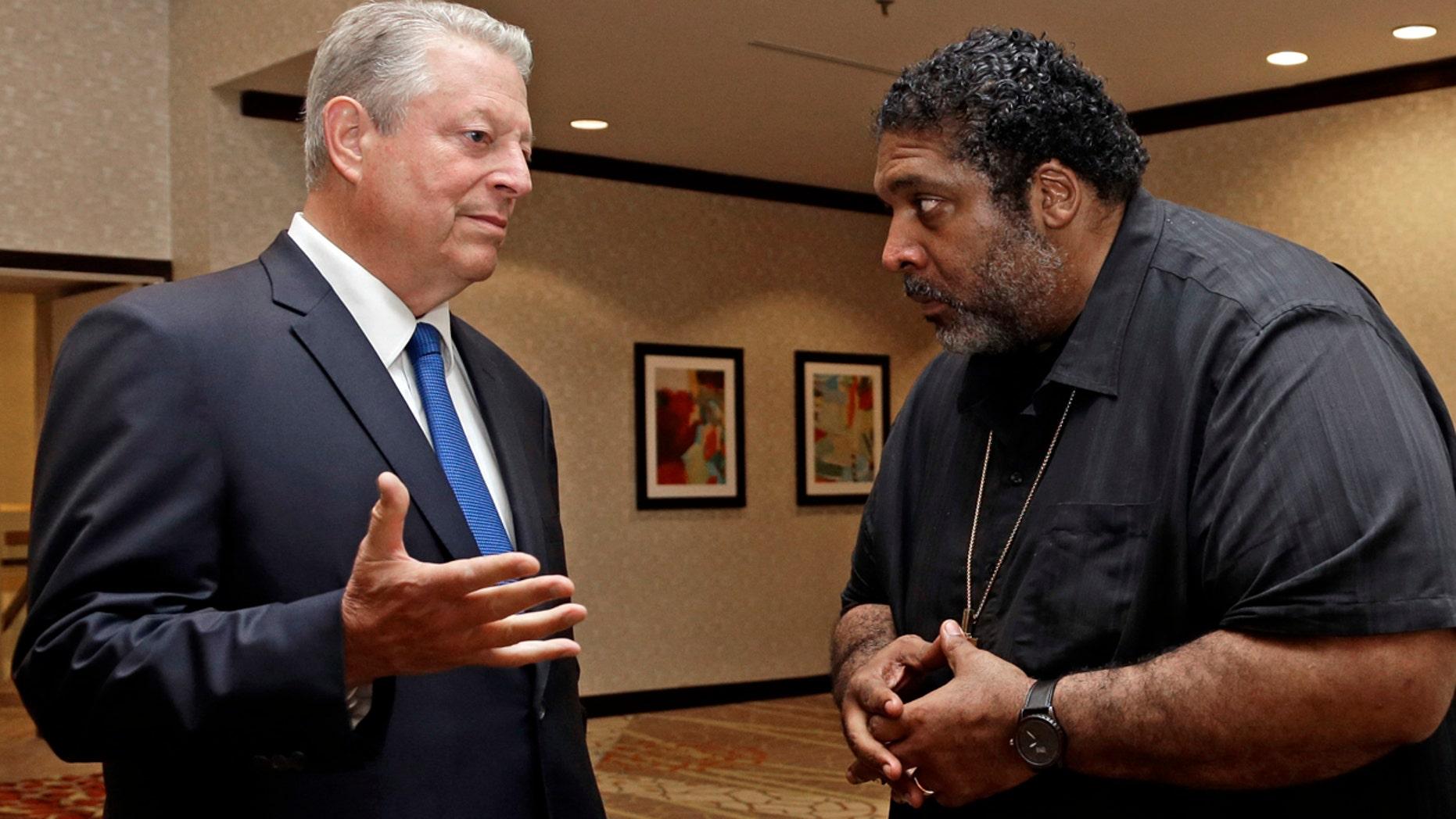Former U.S. Vice President Al Gore, left, speaks with the Rev. Dr. William J. Barber II in Greensboro, N.C.