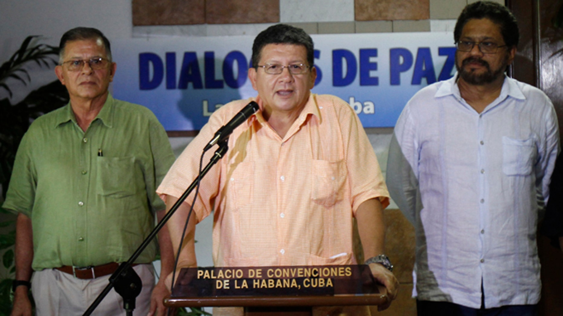 Pablo Catatumbo, chief of the western bloc of the Revolutionary Armed Forces of Colombia, or FARC, center, speaks to journalists accompanied by Ricardo Tellez, left, and Ivan Marquez, chief FARC negotiator during peace talks with Colombia's government in Havana, Cuba, Friday, Aug. 23, 2013. Colombia's largest guerrilla army temporarily walked away from peace talks with the government Friday over President Juan Manuel Santos' refusal to agree to modify the constitution if a peace pact is struck. (AP Photo/Ismael Francisco, Cubadebate)