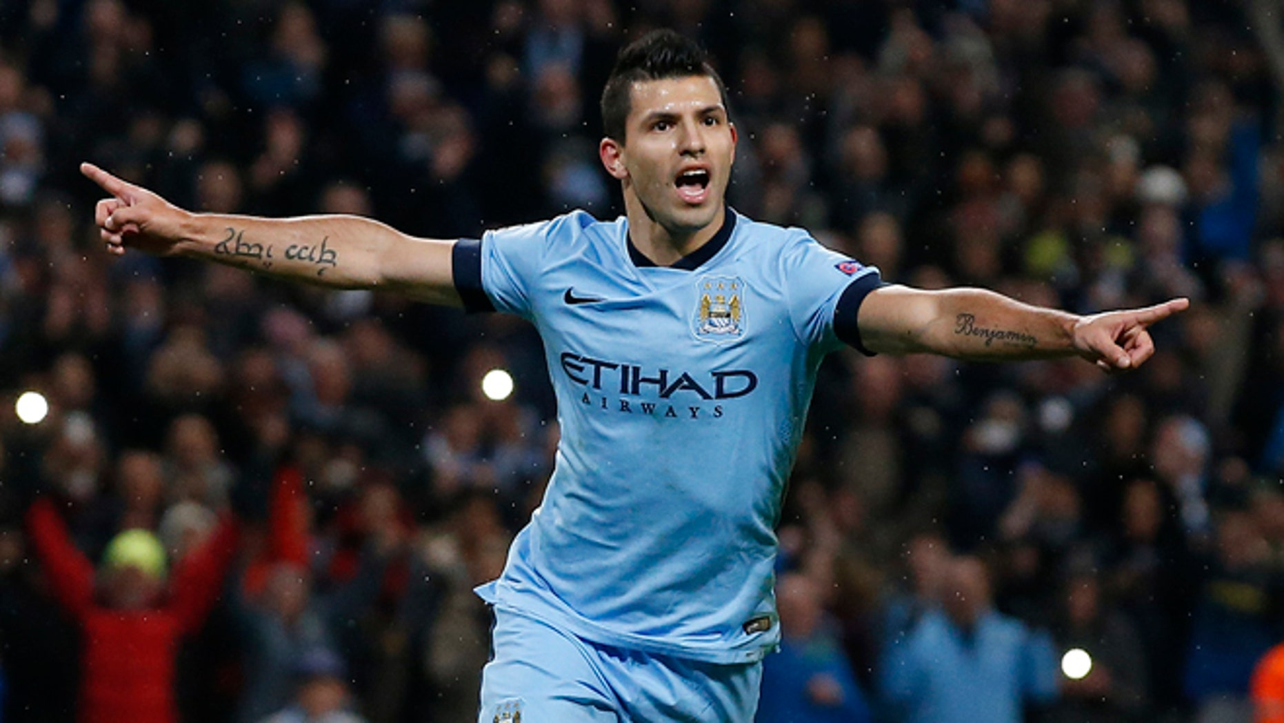 Manchester City's Sergio Aguero celebrates after scoring a penalty on Tuesday, Nov. 25, 2014.
