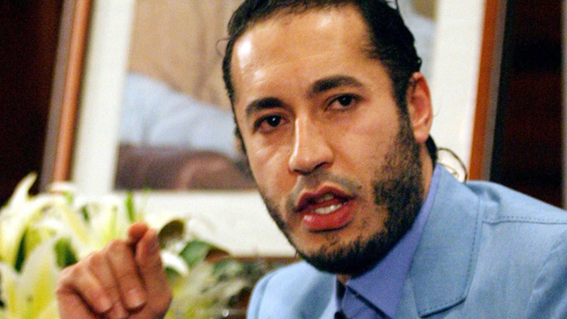 FILE 2005: Al-Saadi Qaddafi, the son of Muammar Qaddafi, answers a question during a press conference in Sydney.
