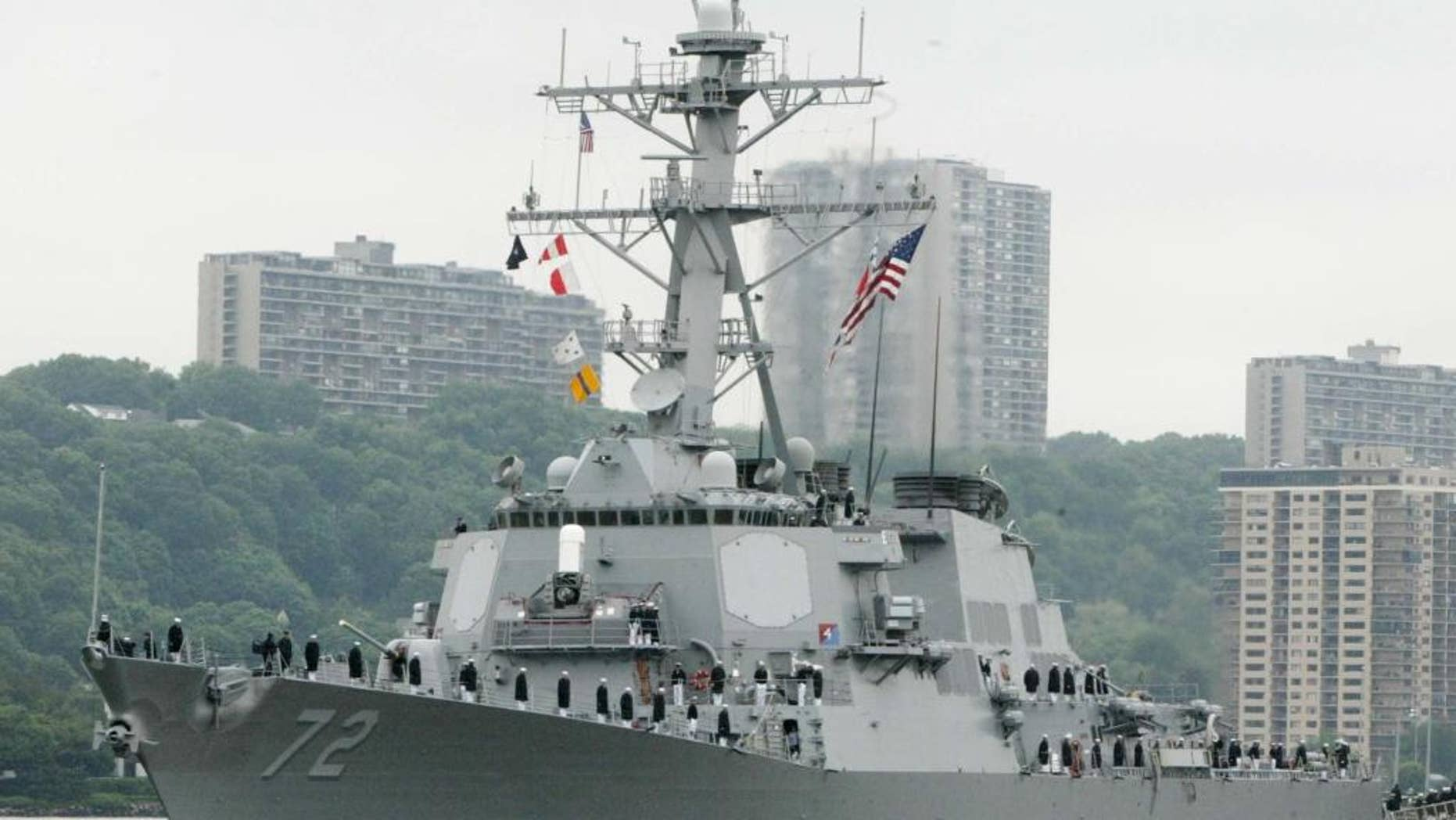 FILE - In this May 26, 2004 file photo, the USS Mahan, a guided-missile destroyer, moves up the Hudson River in New York during Fleet Week. A U.S. Navy guided-missile destroyer fired a warning flare toward an Iranian Revolutionary Guard vessel coming near it in the Persian Gulf, an American official said Wednesday, the latest tense naval encounter between the two countries. (AP Photo/Ed Bailey, File)