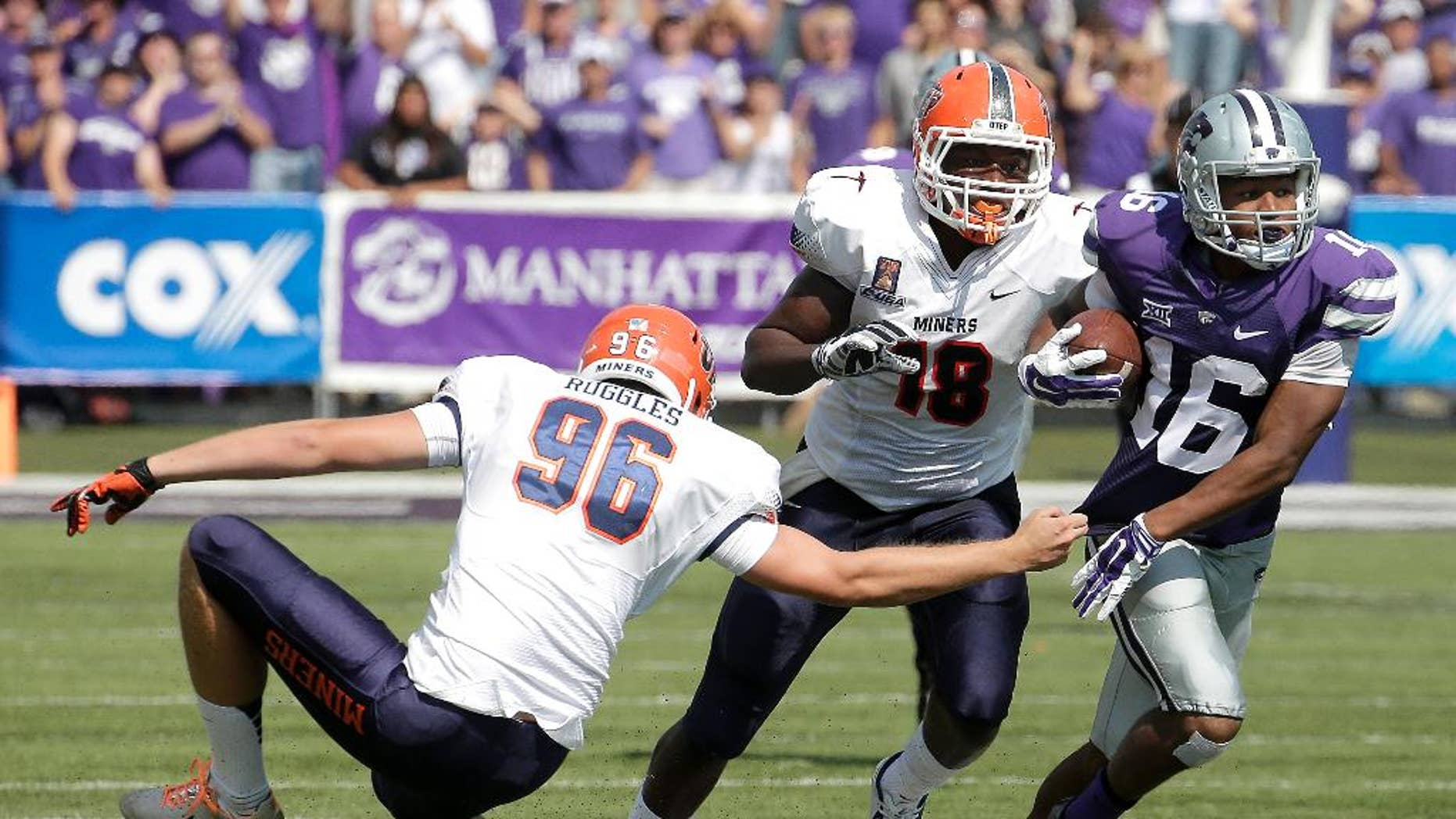 Kansas State wide receiver Tyler Lockett (16) gets past UTEP place kicker Mike Ruggles (96) and tight end Katrae Ford (18) as he returns a punt during the first half of an NCAA college football game, Saturday, Sept. 27, 2014, in Manhattan, Kan. (AP Photo/Charlie Riedel)