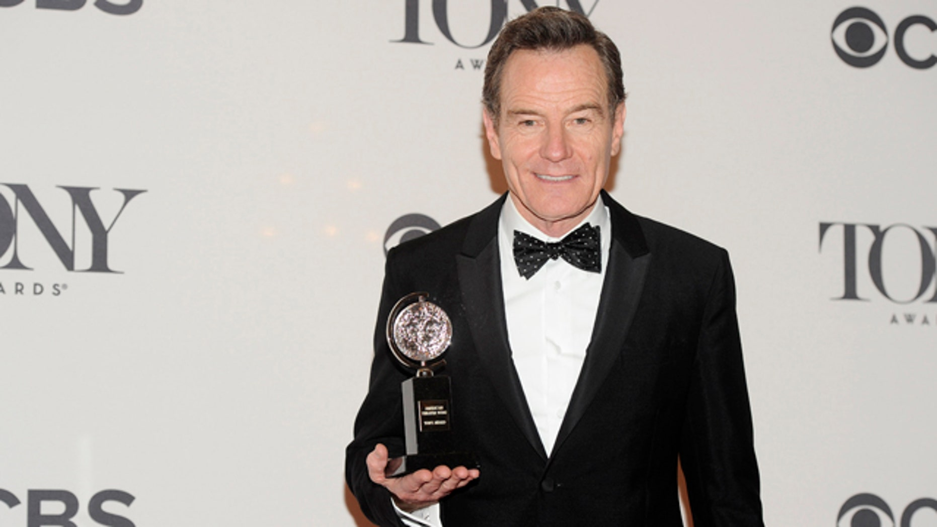 June 8, 2014: Bryan Cranston poses with his award for best actor in a play for 'All the Way' in the press room at the 68th annual Tony Awards at Radio City Music Hall in New York. (Photo by Charles Sykes/Invision/AP)
