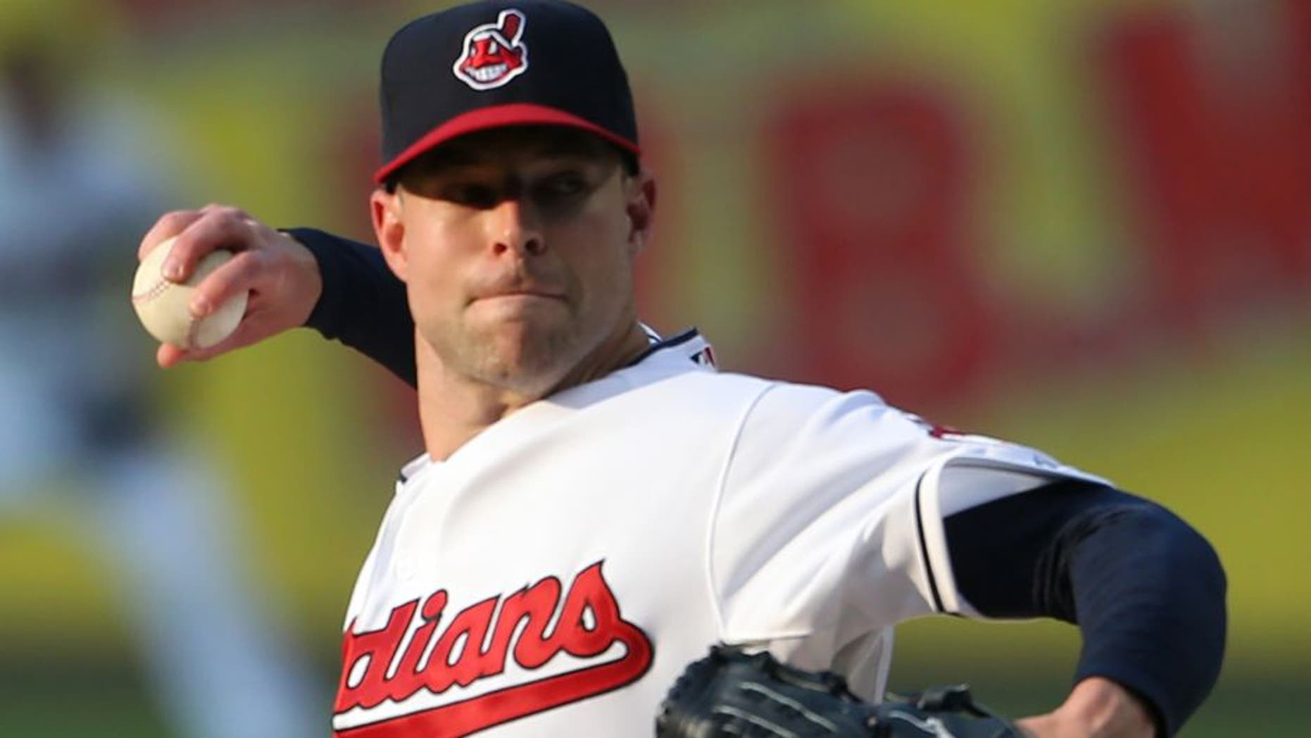 Cleveland Indians starting pitcher Corey Kluber pitches to Seattle Mariners' Austin Jackson during the first inning of a baseball game, Tuesday, June 9, 2015, in Cleveland. (AP Photo/Ron Schwane)