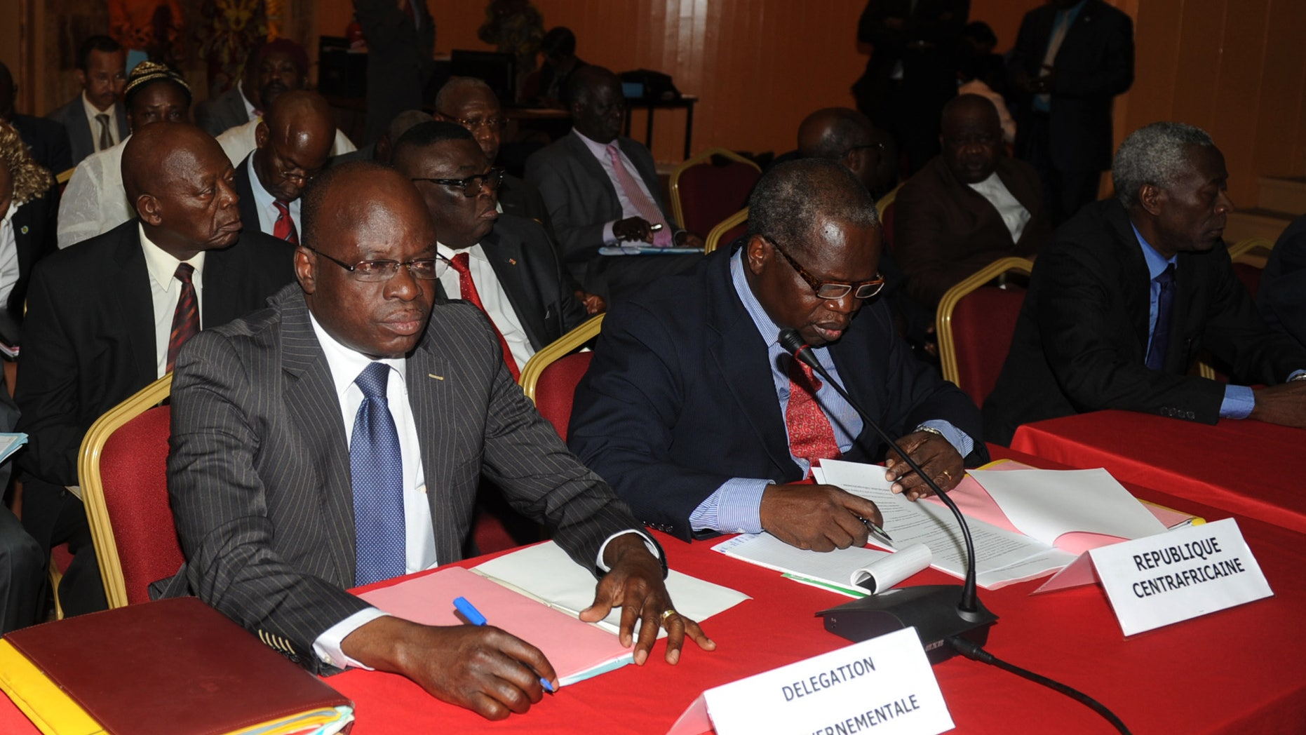 Members of the Central African Republic government delegation await the opening of peace talks with the Seleka rebel alliance, who have taken control of much of the country's north, in Libreville, Gabon, Wednesday, Jan. 9, 2013. Gabon government officials say that talks on the crisis in Central African Republic began Wednesday with representatives of the government, rebels and other groups gathering in this nearby country.(AP Photo/Joel Bouopda Tatou)