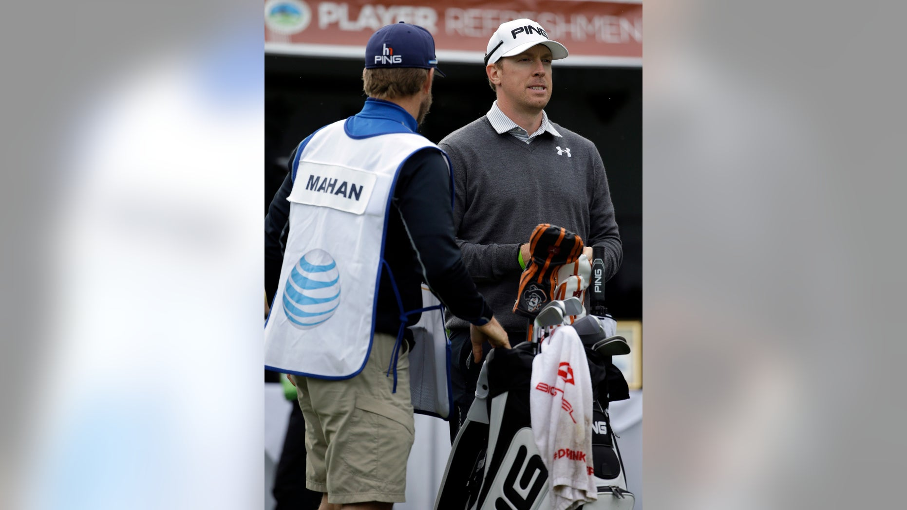 Hunter Mahan, right, waits to hit off the first tee on Friday, Feb. 7, 2014, during the second round of the AT&T Pebble Beach Pro-Am golf tournament on the Spyglass Hill Golf Course in Pebble Beach, Calif. (AP Photo/Ben Margot)