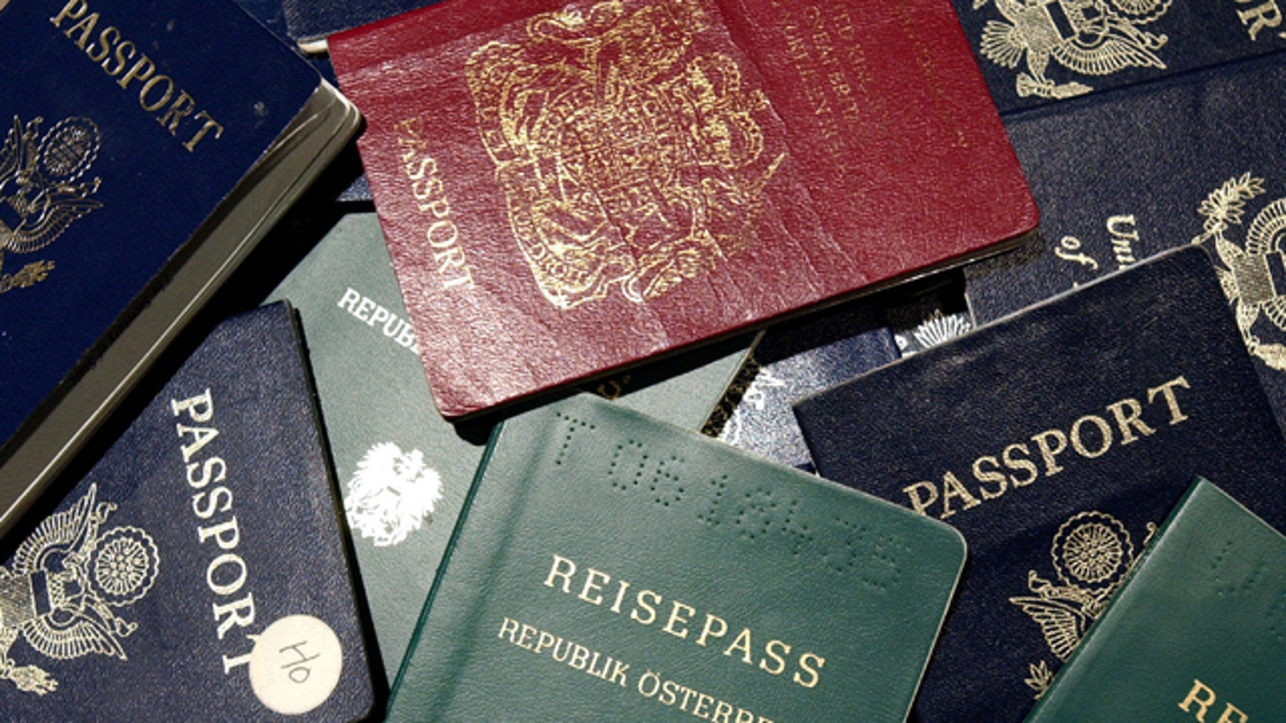 SAN FRANCISCO - JUNE 14:  Counterfeit passports are shown at San Francisco International Airport June 14, 2002 in California. At more than 300 ports of entry across the U.S., a new system known as DataShare is being used to enable U.S. Immigration and Naturalization Service (INS) inspectors to see biographical information and photographs of visa holders who receive their documents at consular posts around the world.  (Photo by Justin Sullivan/Getty Images)