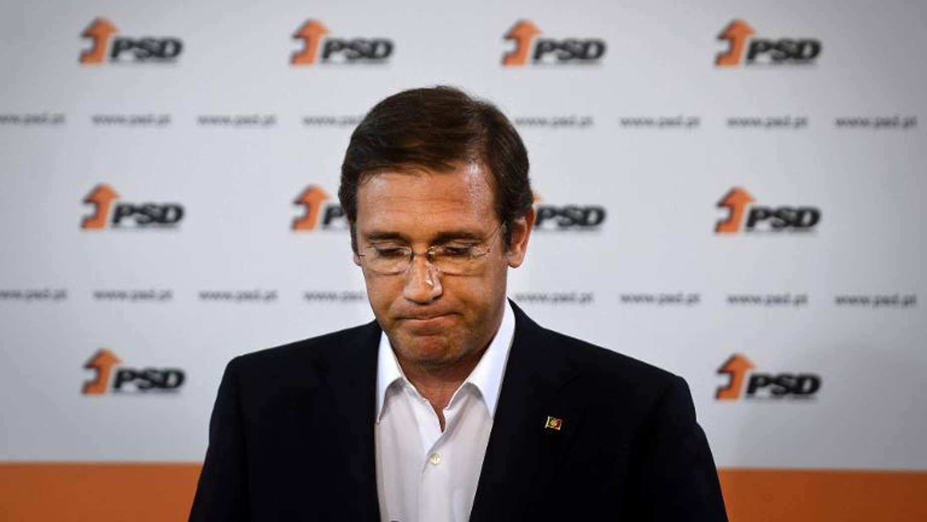 Portuguese Prime Minister Pedro Passos Coelho delivers a speech after the results of Portugal local elections in Lisbon, on September 29, 2013