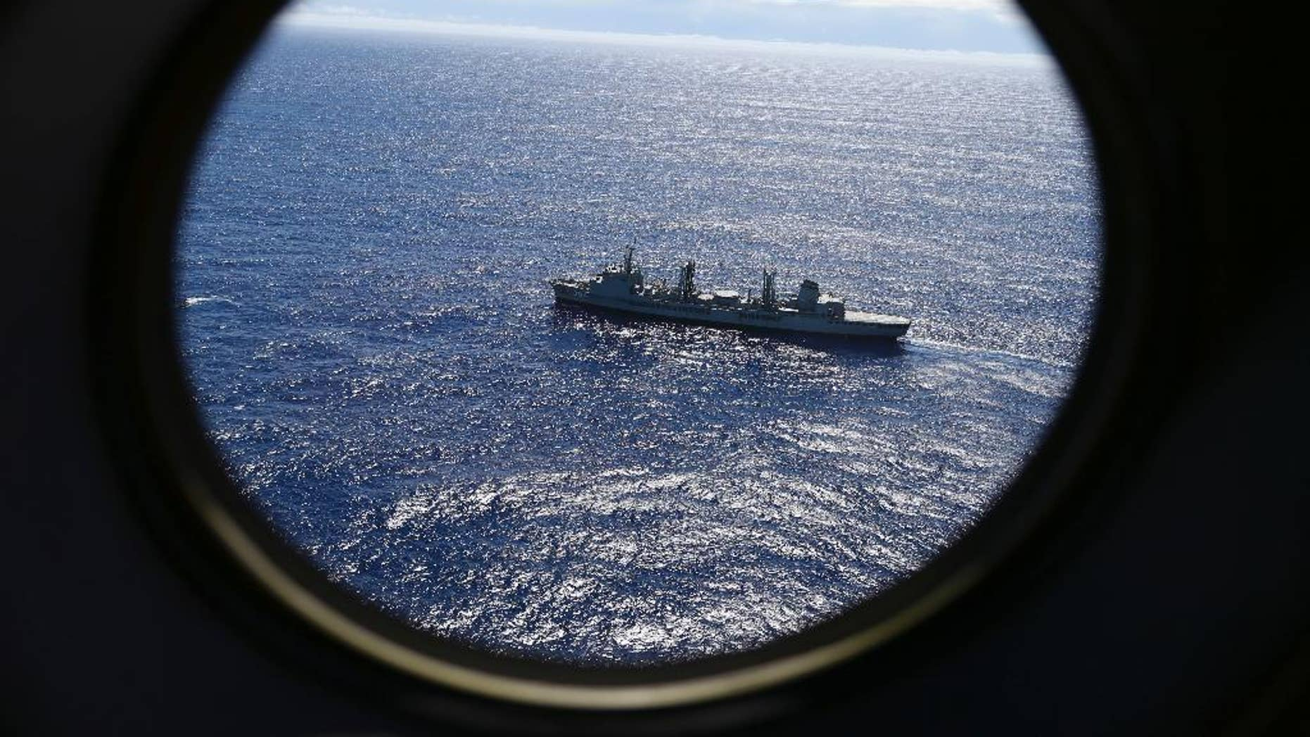 FILE - In this March 31, 2014, file photo, HMAS Success scans the southern Indian Ocean, near the coast of Western Australia, as a Royal New Zealand Air Force P3 Orion flies over, while searching for missing Malaysia Airlines Flight MH370. A Dutch survey ship Fugro Equator will finish the search of the southern Indian Ocean for Malaysia Airlines Flight 370 alone after resupplying at the southwest Australian port of Fremantle, the Australian Transport Safety Bureau, which coordinates the search, said in a statement. (AP Photo/Rob Griffith, File)