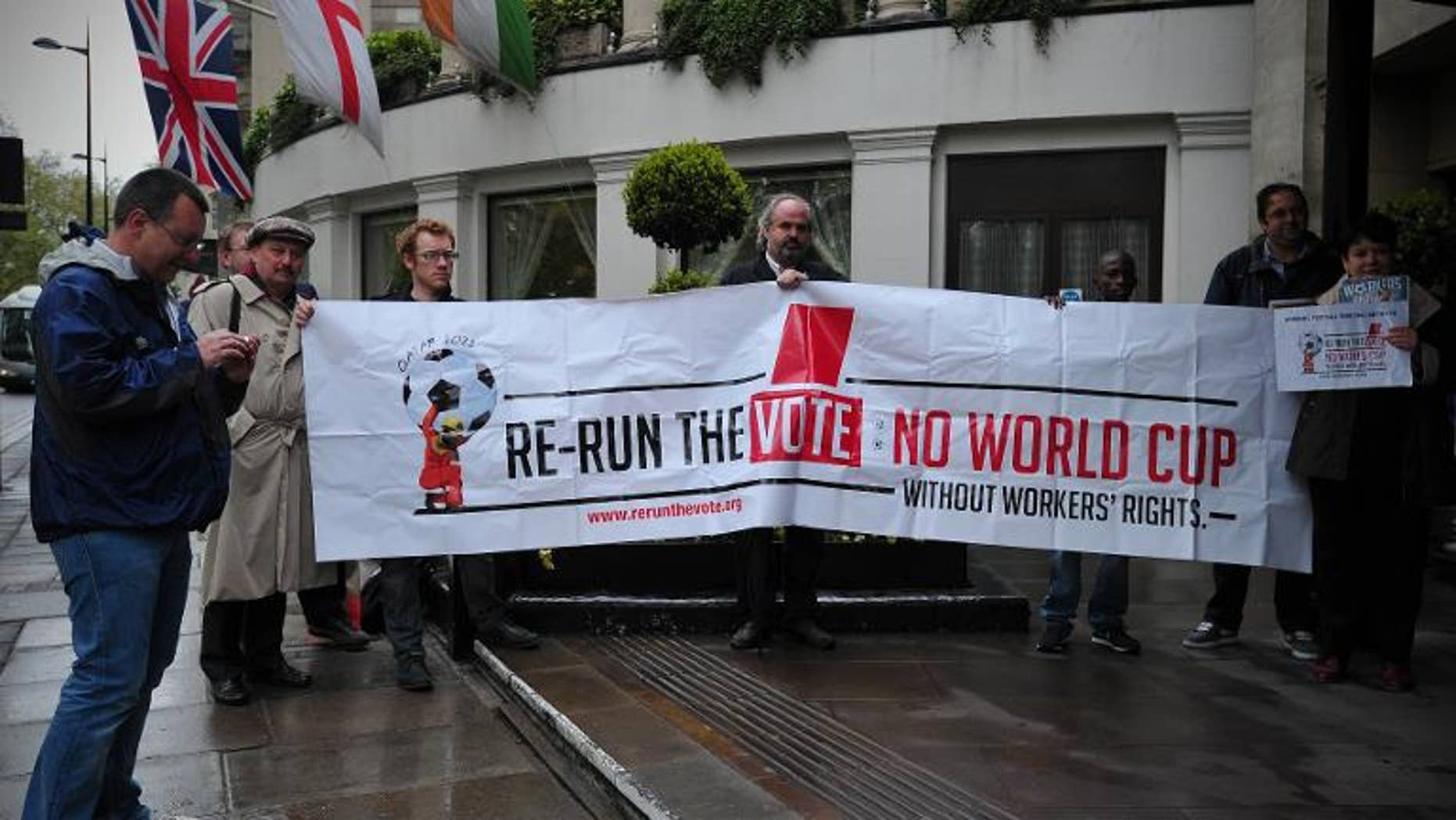 Protesters demonstrate against the perceived exploitation of workers in Qatar, the location of the 2022 World Cup, before a UEFA Congress in central London on May 24, 2013