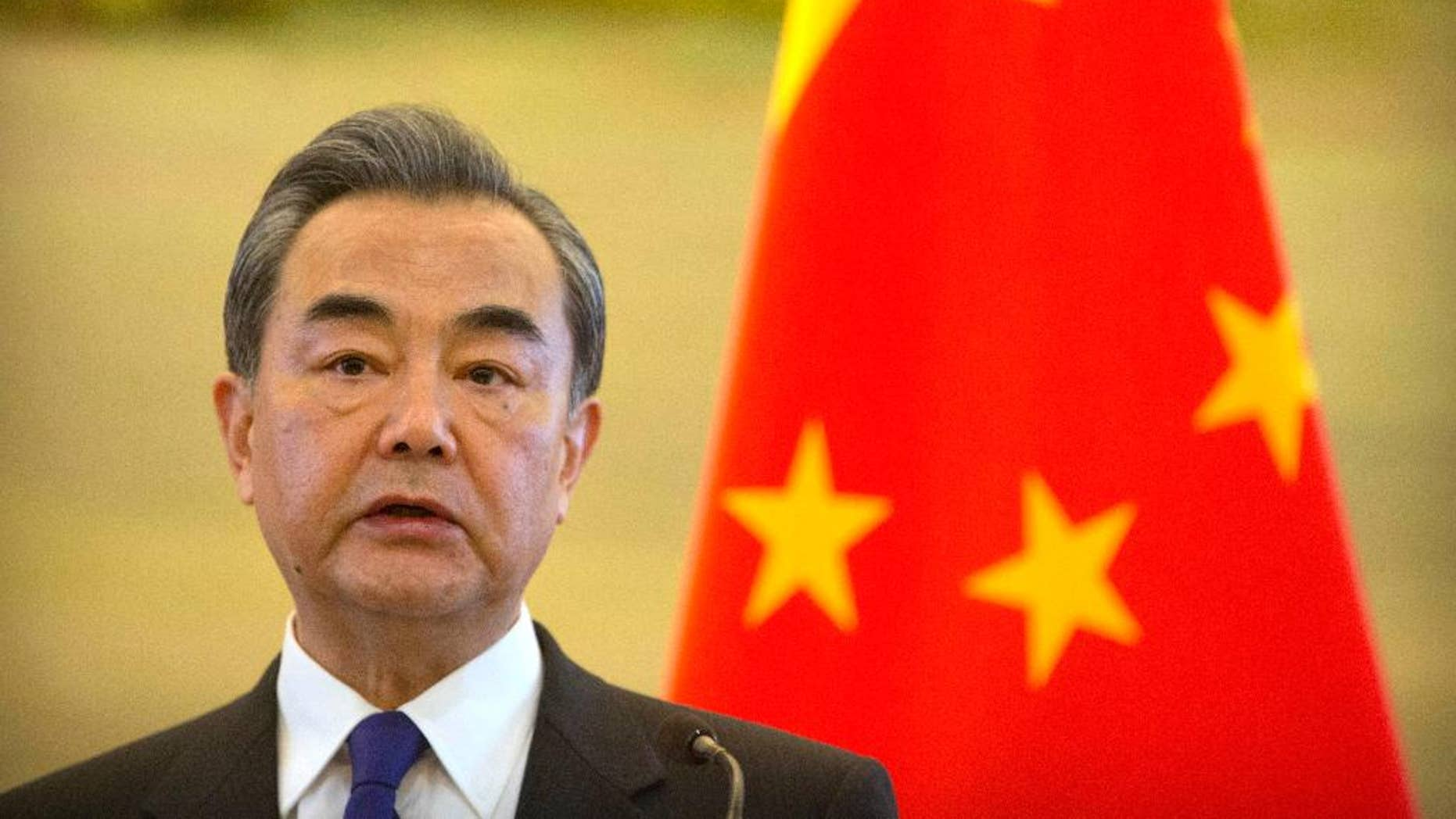 FILE - In this Thursday, April 13, 2017 file photo, Chinese Foreign Minister Wang Yi speaks during a joint press conference with the Palestinian Foreign Minister at the Ministry of Foreign Affairs in Beijing. Wang made a new appeal for calm on the Korean peninsula Tuesday, April 18, 2017, and said he believes the United States would prefer a diplomatic rather than military resolution to the standoff. (AP Photo/Mark Schiefelbein, File)