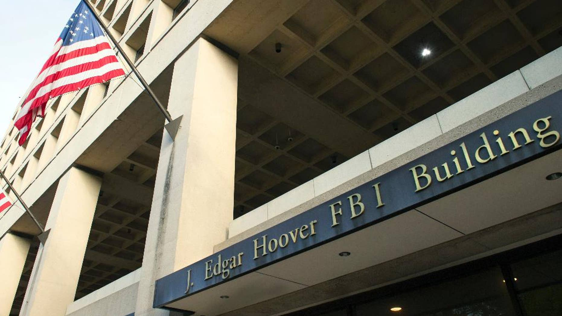 FILE - In this Nov. 2, 2016, file photo, the FBI's J. Edgar Hoover headquarter building in Washington. (AP Photo/Cliff Owen, File)