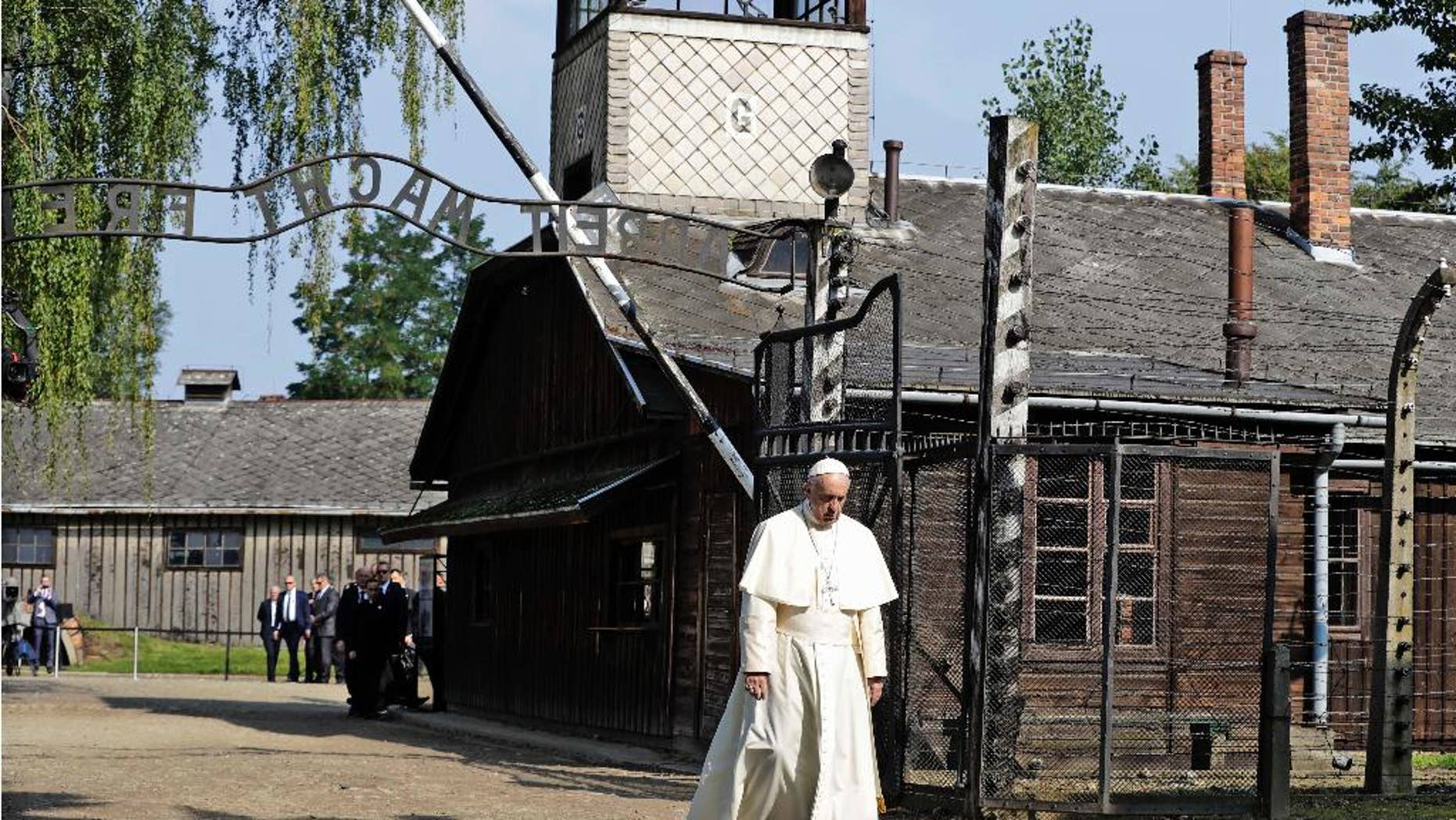 July 29, 2016: Pope Francis walks through the gate of the former Nazi German death camp of Auschwitz in Oswiecim, Poland.