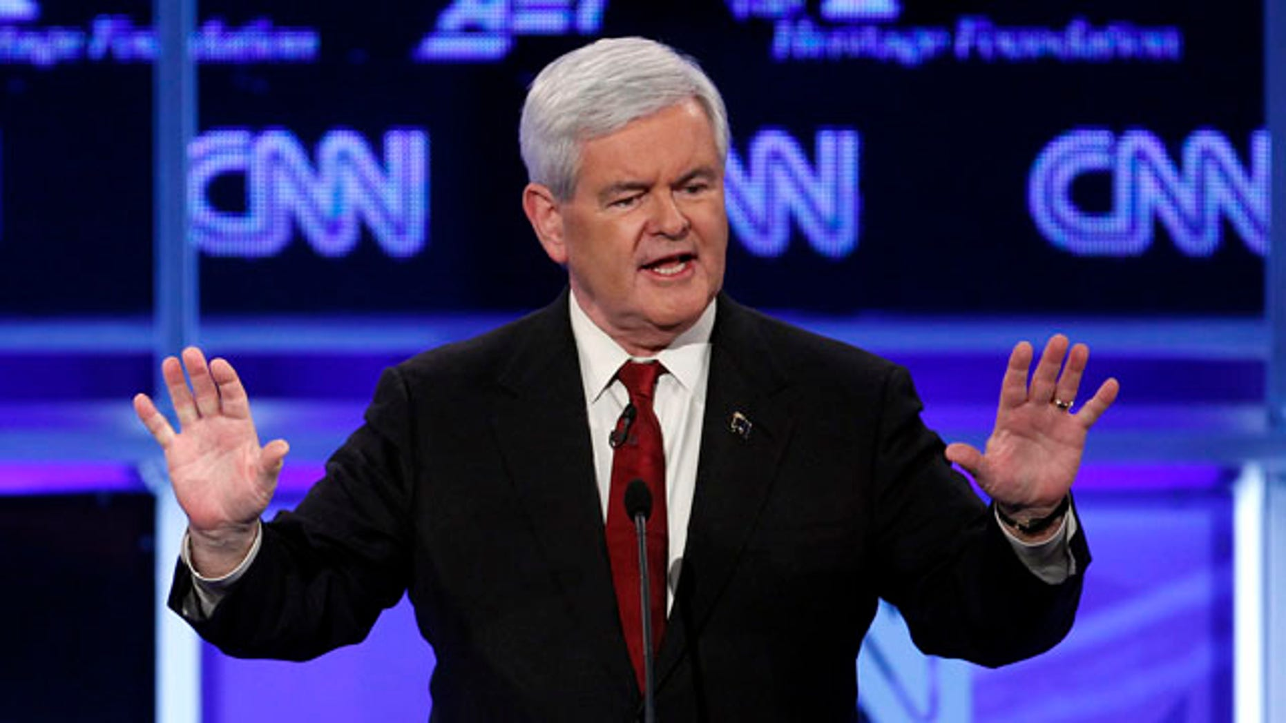 El aspirante a la candidatura presidencial republicana y ex presidente de la Cámara de Representantes Newt Gingrich habla durante un debate de precandidatos republicanos en Washington DC, la noche del martes 22 de noviembre de 2011. (Foto AP/Evan Vucci)