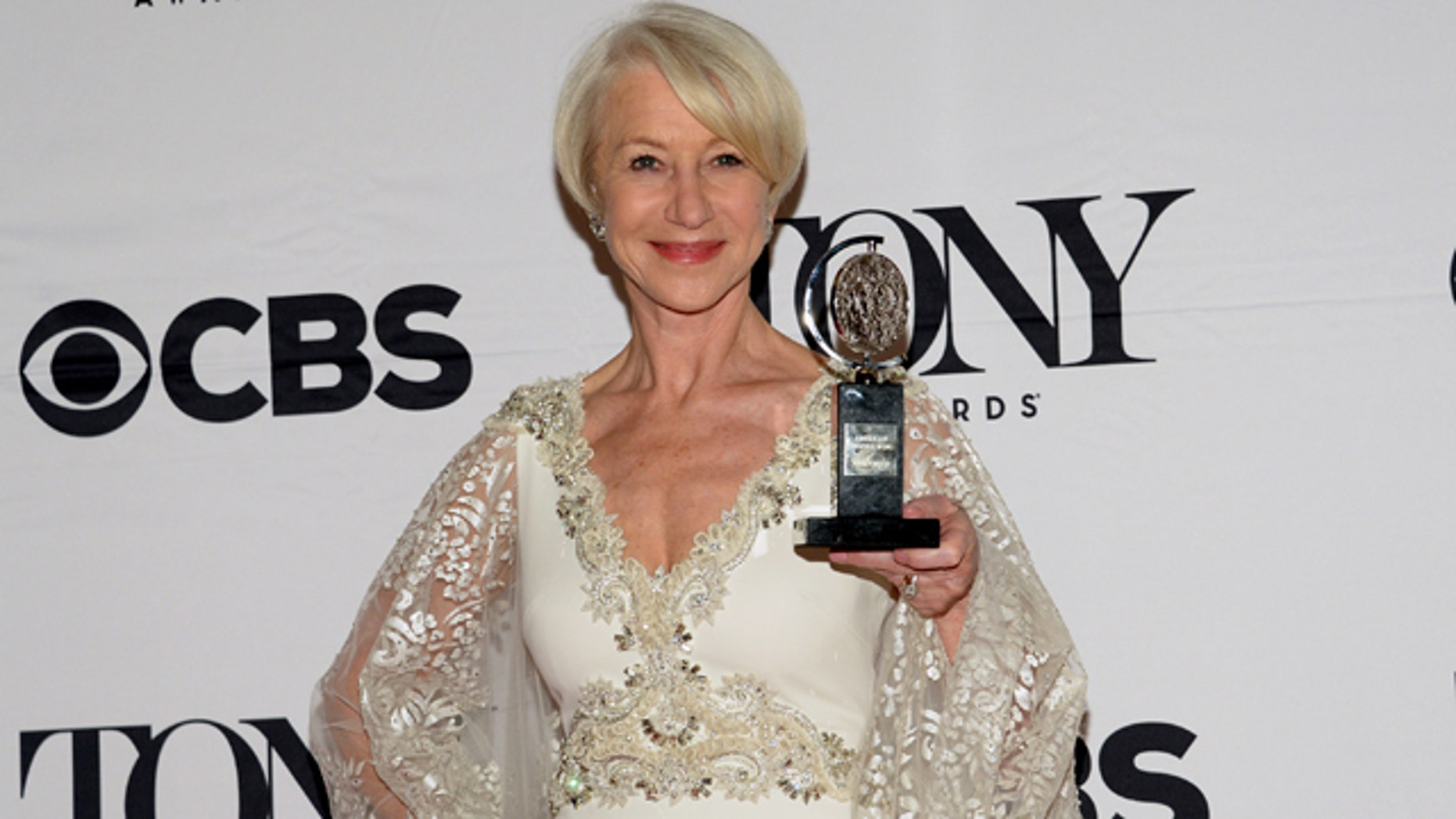 June 7, 2015: Helen Mirren poses in the press room with the award for best performance by an actress in a leading role in a play for The Audience at the 69th annual Tony Awards in New York. (Photo by Evan Agostini/Invision/AP)