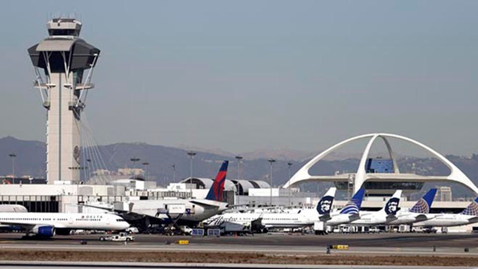 Airplanes sit on the tarmac at Los Angeles International Airport Friday, Nov. 1, 2013.  (AP Photo/Gregory Bull)