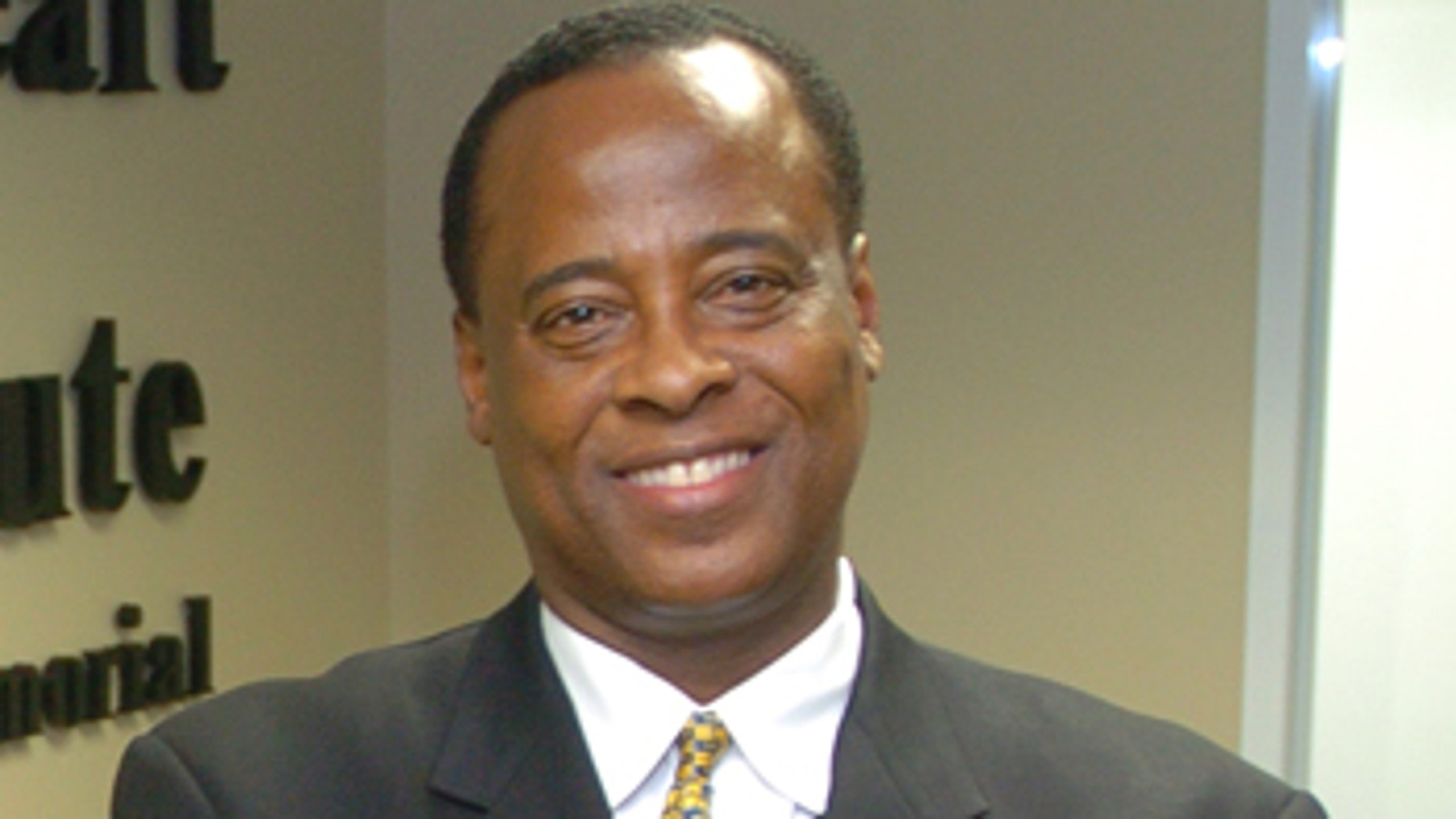 In this July 7, 2006 photo, Dr. Conrad Murray poses for a photo as he opens the Acres Homes Cardiovascular Center at the Tidwell Professional Building, in Houston. A woman who answered the phone Friday, June 26, 2009, at Dr. Conrad C. Murray's clinic in Houston confirmed to The Associated Press that Murray was Michael Jackson's cardiologist. Los Angeles police say they want to speak to the doctor but stressed he was not under criminal investigation. (AP Photo/Houston Chronicle)