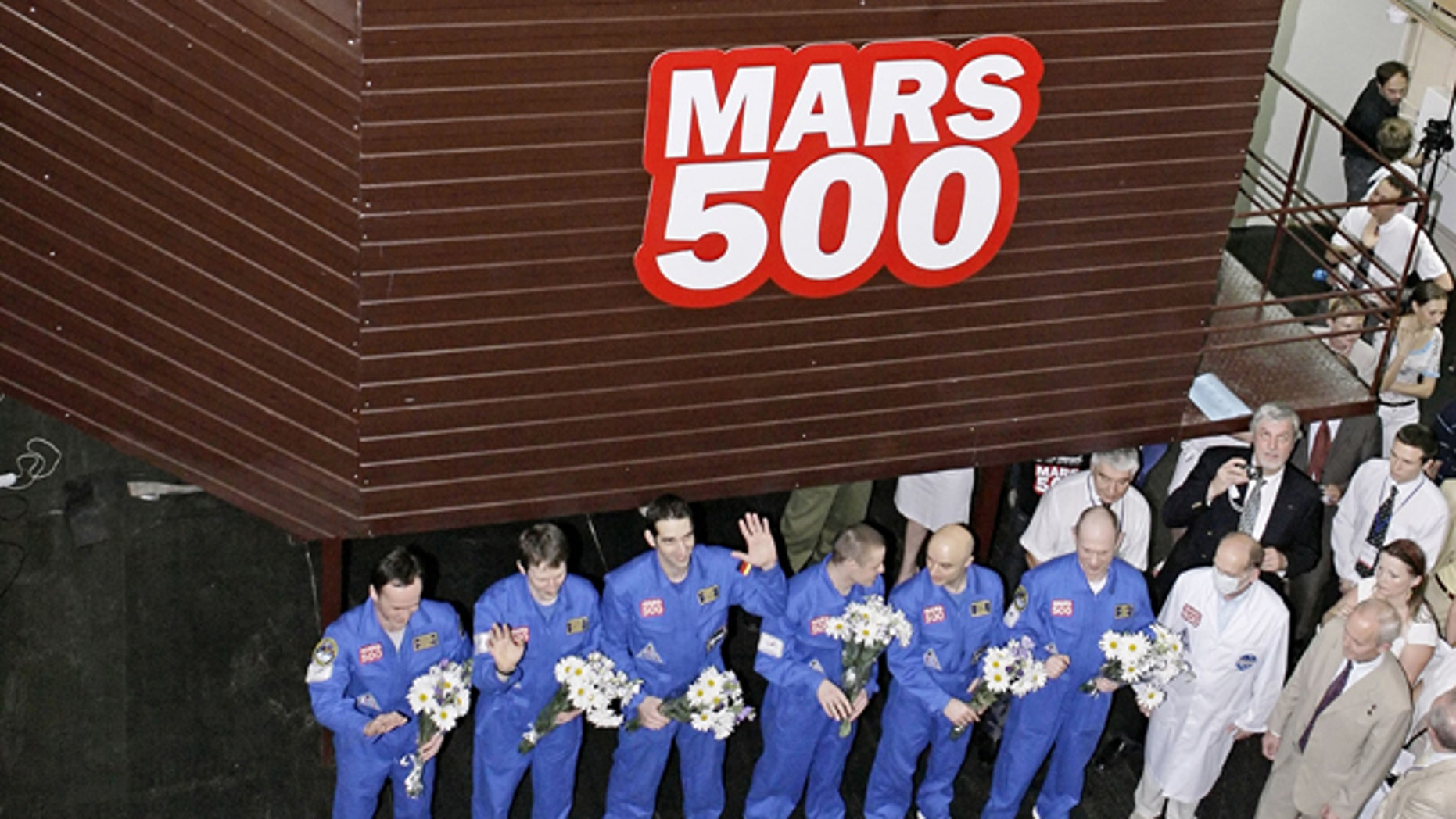 The team of researchers is greeted after ending a three-month simulation mission to Mars at a Moscow research facility, Russia. Another team of researchers will launch a longer, 520-day simulation of Mars mission at the same facility in Moscow on Thursday June 3, 2010.
