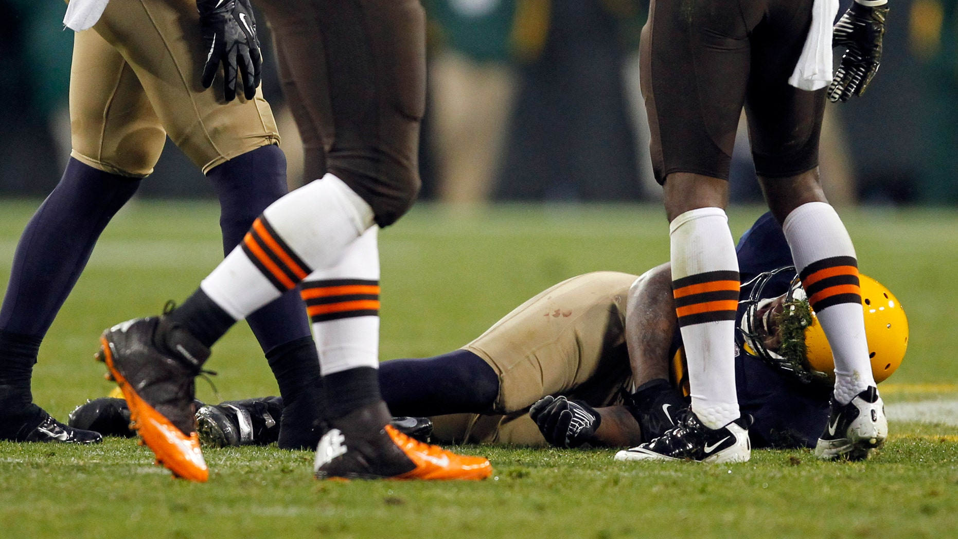 Green Bay Packers' Jermichael Finley lays on the field after being injured during the second half of an NFL football game against the Cleveland Browns Sunday, Oct. 20, 2013, in Green Bay, Wis. Finley left the game on a stretcher. (AP Photo/Mike Roemer)