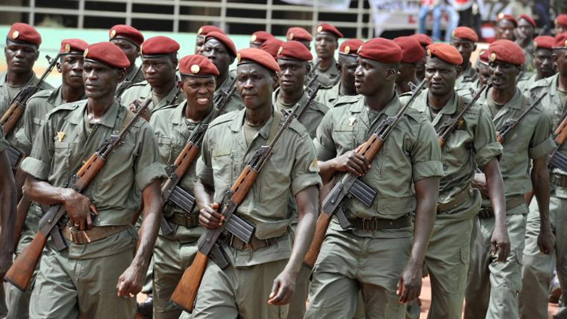 Army forces march during the inauguration of Mali's new president on September 19, 2013 in Bamako