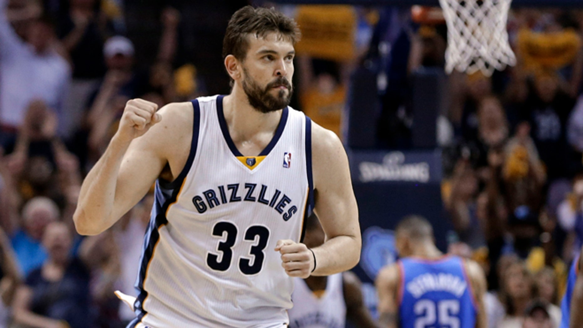 FILE - In this April 24, 2014, file photo, Memphis Grizzlies center Marc Gasol celebrates after scoring against the Oklahoma City Thunder in overtime of Game 3 of an opening-round NBA basketball playoff series in Memphis, Tenn. Marc Gasol has confirmed that he will sign a new five-year contract with the Memphis Grizzlies. The 30-year-old free agent tells Spanish media he will stay at Memphis, as The Associated Press reported on Monday, July 6, 2015. The deal is expected to be worth more than 100 million dollars. (AP Photo/Mark Humphrey, File)