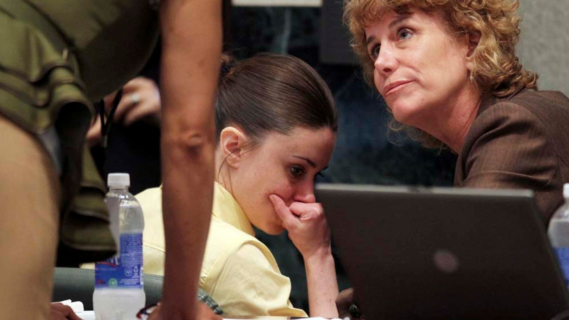 Casey Anthony, with her attorney Dorothy Clay Sims, is seen during a court recess following the state's closing arguments in her murder trial in Orlando, Fla.