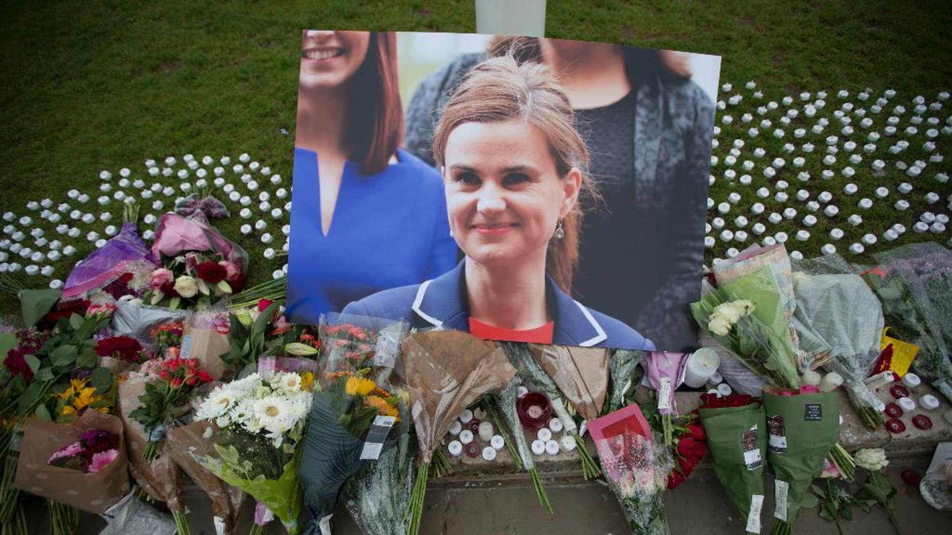 An image and floral tributes for Jo Cox on Parliament Square, outside the House of Parliament in London.