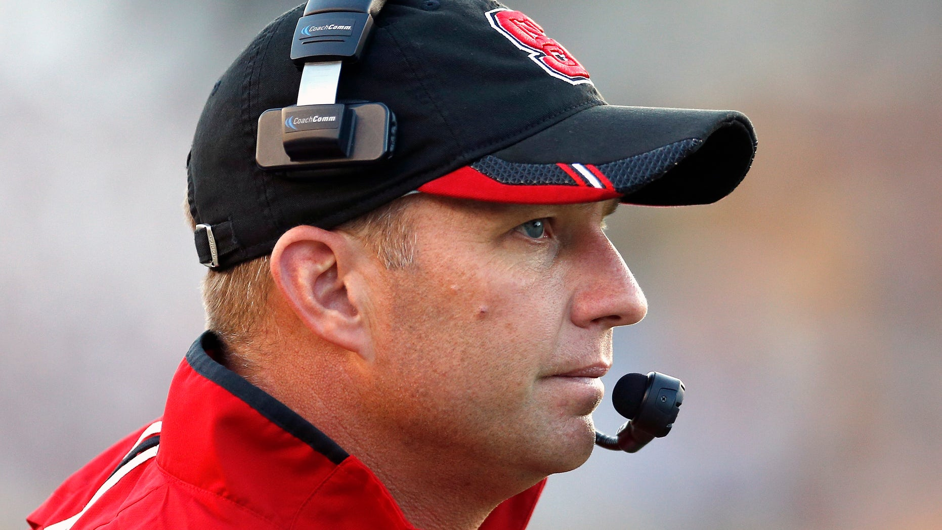 North Carolina State head coach Dave Doeren watches from the sideline in the fourth quarter of an NCAA college football game against  Boston College in Boston, Saturday, Nov. 16, 2013. Boston College won 38-21. (AP Photo/Michael Dwyer)